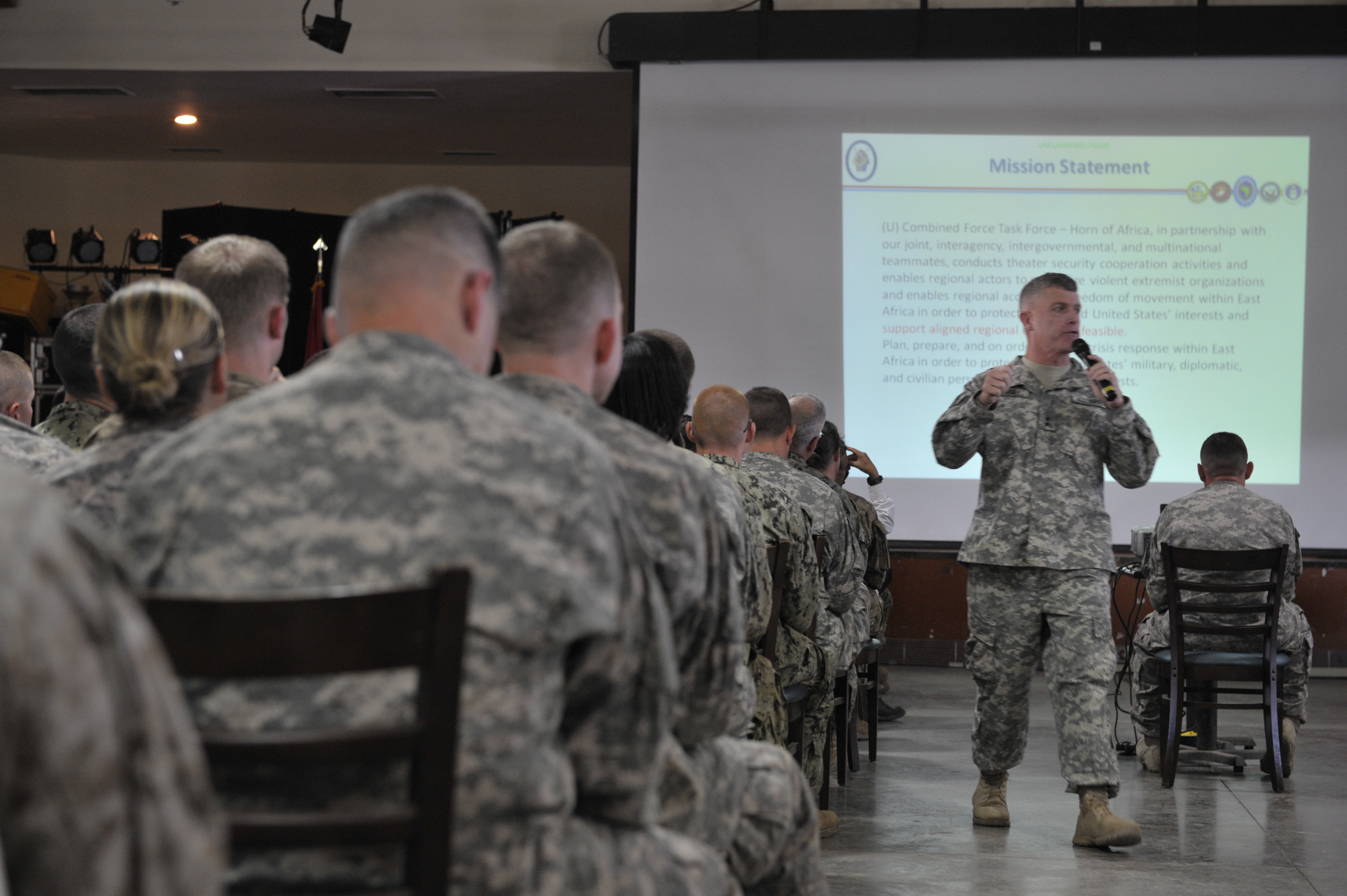 Maj. Gen. Wayne W. Grigsby, Jr., Combined Joint Task Force-Horn of Africa commanding general, speaks to service members during a CJTF-HOA All Hands Call at Camp Lemonnier, Djibouti on Nov. 7, 2015. Grigsby is set to relinquish command of CJTF-HOA on April 14, 2015, after serving 14 months as commanding general. (U.S. Air Force photo by Tech. Sgt. Ian Dean)