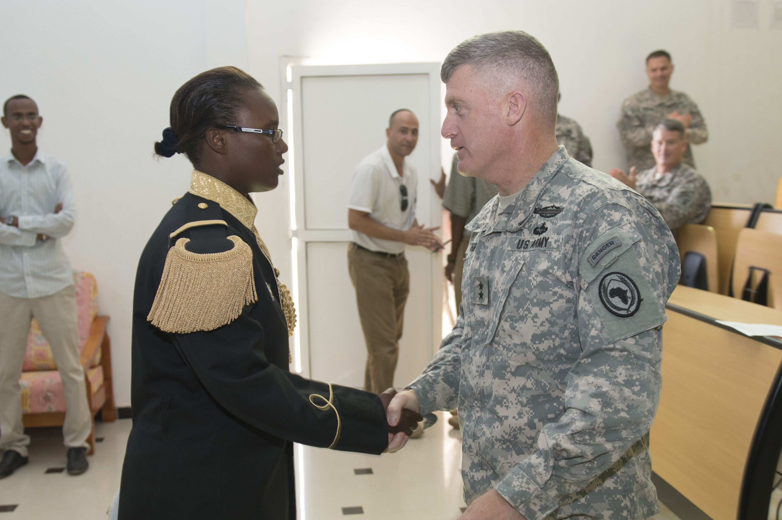 Maj. Gen. Wayne W. Grigsby, Jr., Combined Joint Task Force-Horn of Africa commanding general, meets with a Djiboutian cadet during a visit to Joint Military Academy of Arta in Arta, Djibouti on Dec. 27, 2014. AS CJTF-HOA commanding general, Grigsby mentored junior members at Partner Nation military academies. (U.S. Air Force photo by Staff Sgt. Carlin Leslie)