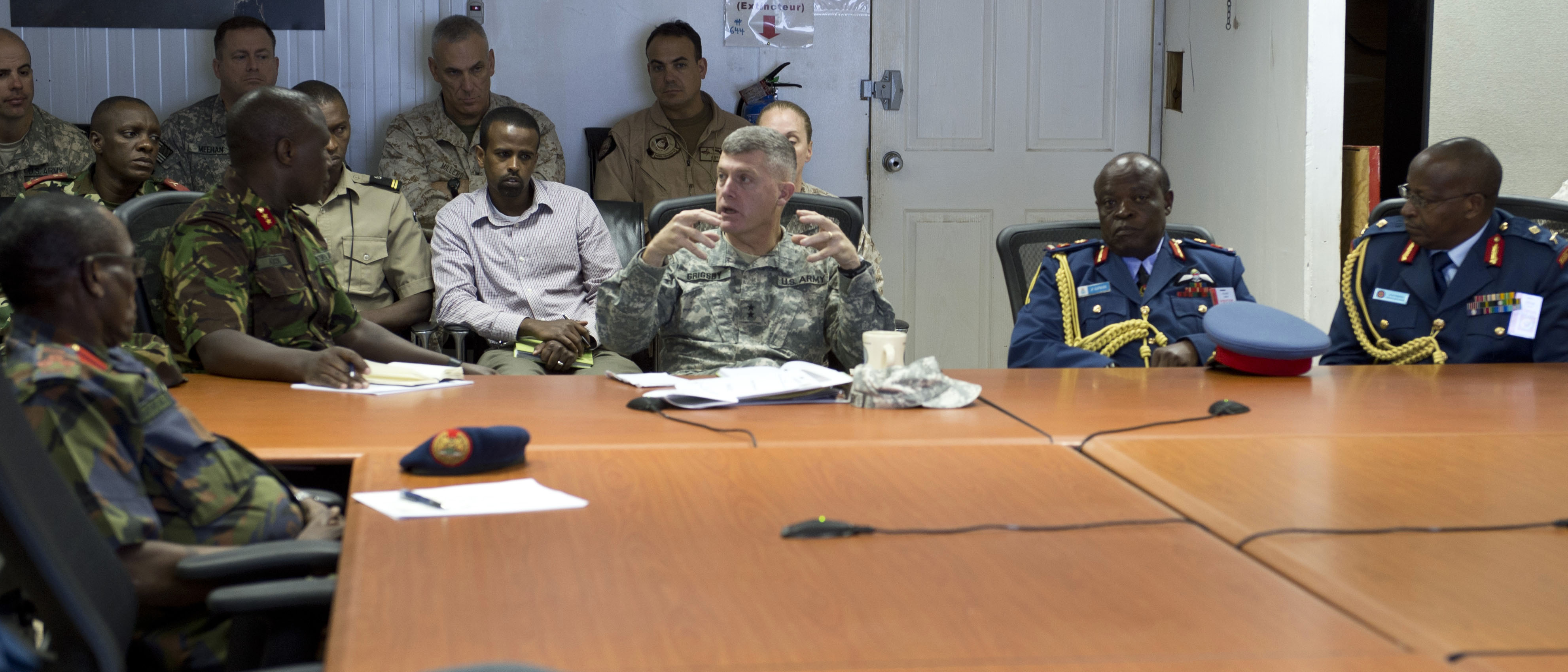 Maj. Gen. Wayne W. Grigsby, Jr., Combined Joint Task Force-Horn of Africa commanding general, meets with East Africa military Leaders at Camp Lemonnier, Djibouti on Feb. 11, 2015. Grigsby directly engaged with the Partner Nations' military leaders to understand what the Profession of Arms meant to each individual country and encouraged them to instill these principles at all levels of military service. (U.S. Air Force photo by Staff Sgt Kevin Iinuma)