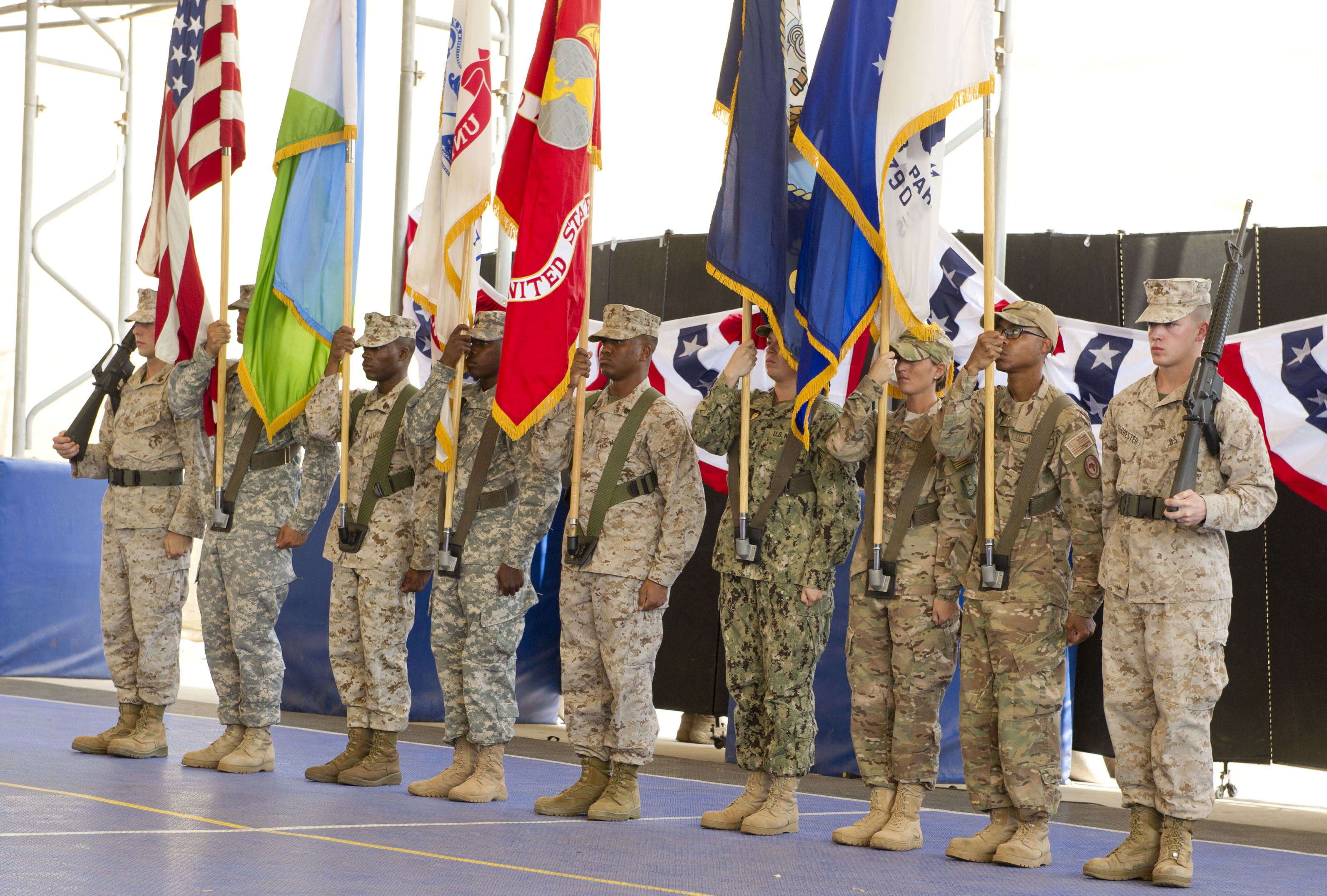 The Combined Joint Task Force-Horn of Africa joint service color guard presents colors during the CJTF-HOA Change of Command ceremony at Camp Lemonnier, Djibouti on April 14, 2015. U.S. Army Gen. David Rodriguez, U.S. Africa Command commander, presided over the ceremony where U.S. Army Maj. Gen. Mark Stammer assumed command of CJTF-HOA from Maj. Gen. Wayne W. Grigsby, Jr. (U.S. Air Force photo by Tech. Sgt. Ian Dean)