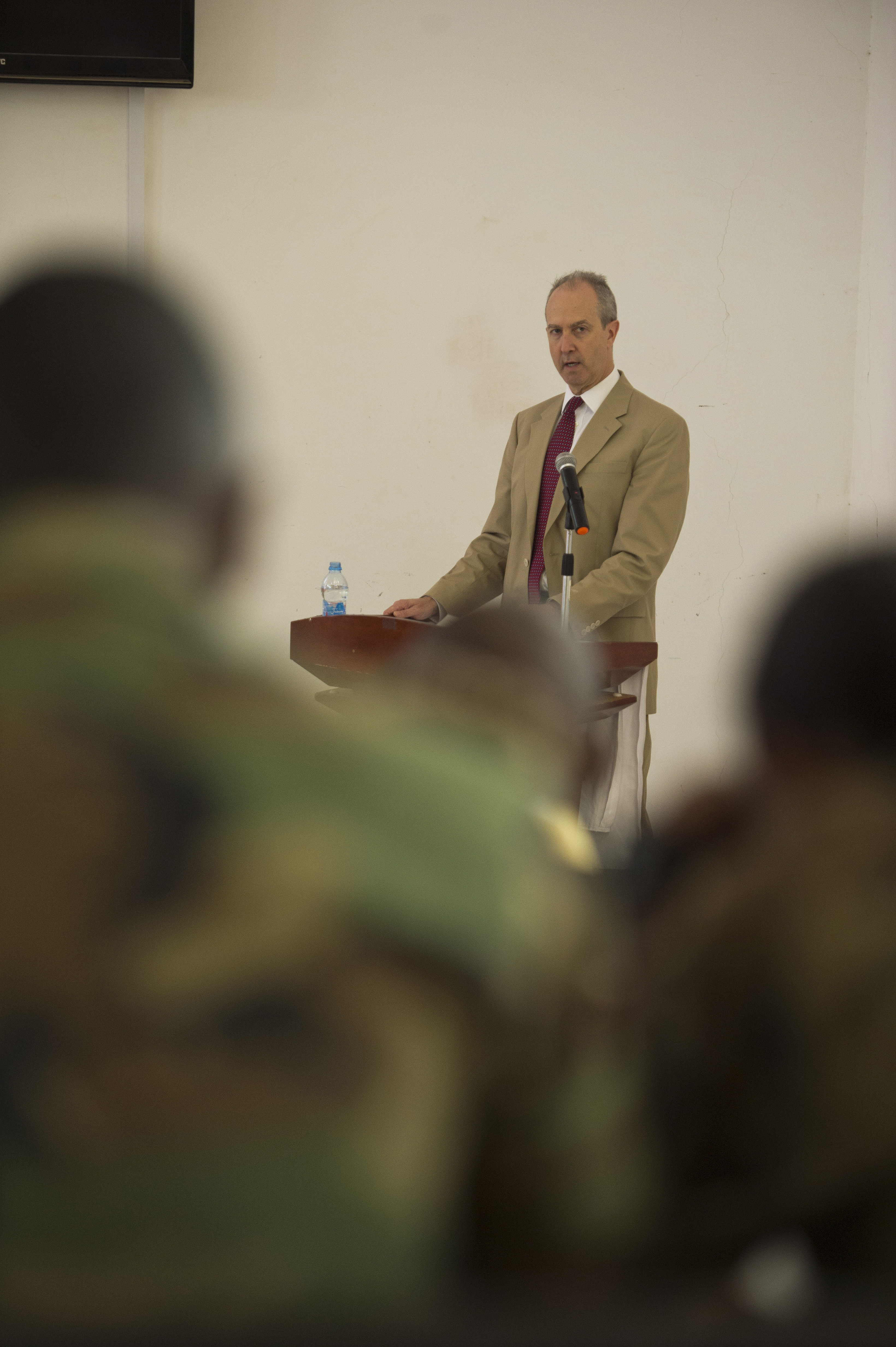 Tom Kelly, U.S. Ambassador to Djibouti, speaks to cadets at the first ever Geo-Strategy Meeting at the Joint Military Academy of Arta, Arta, Djibouti, April 20, 2015. Kelly was one of three guest speakers at the event discussing the importance of military and law enforcement leaders to plan for the protection of civilians and their livelihoods when performing military actions. (U.S. Air Force photo by Staff Sgt. Nathan Maysonet)