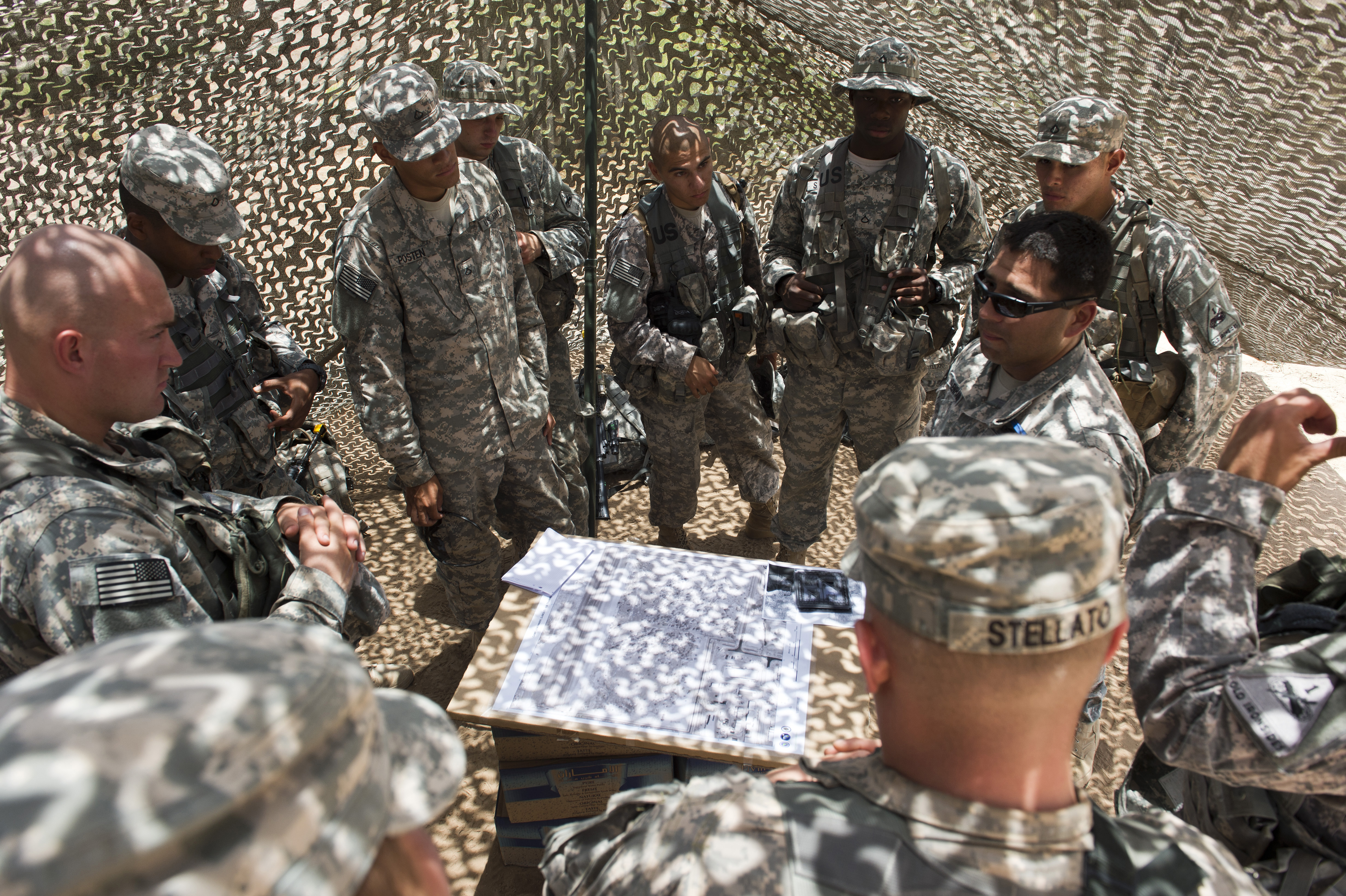 Staff Sgt. Billy Mollenhauer, 1st Battalion, 77th Armor Regiment infantry squad leader, briefs soldiers from the 1/77 AR Rgt. on land navigation in preparation for the Expert Infantry Badge assessment on Camp Lemonnier, Djibouti, April 15, 2015. Land navigation is one of several skills EIB candidates are graded on during the assessment course. (U.S. Air Force photo by Staff Sgt. Nathan Maysonet)