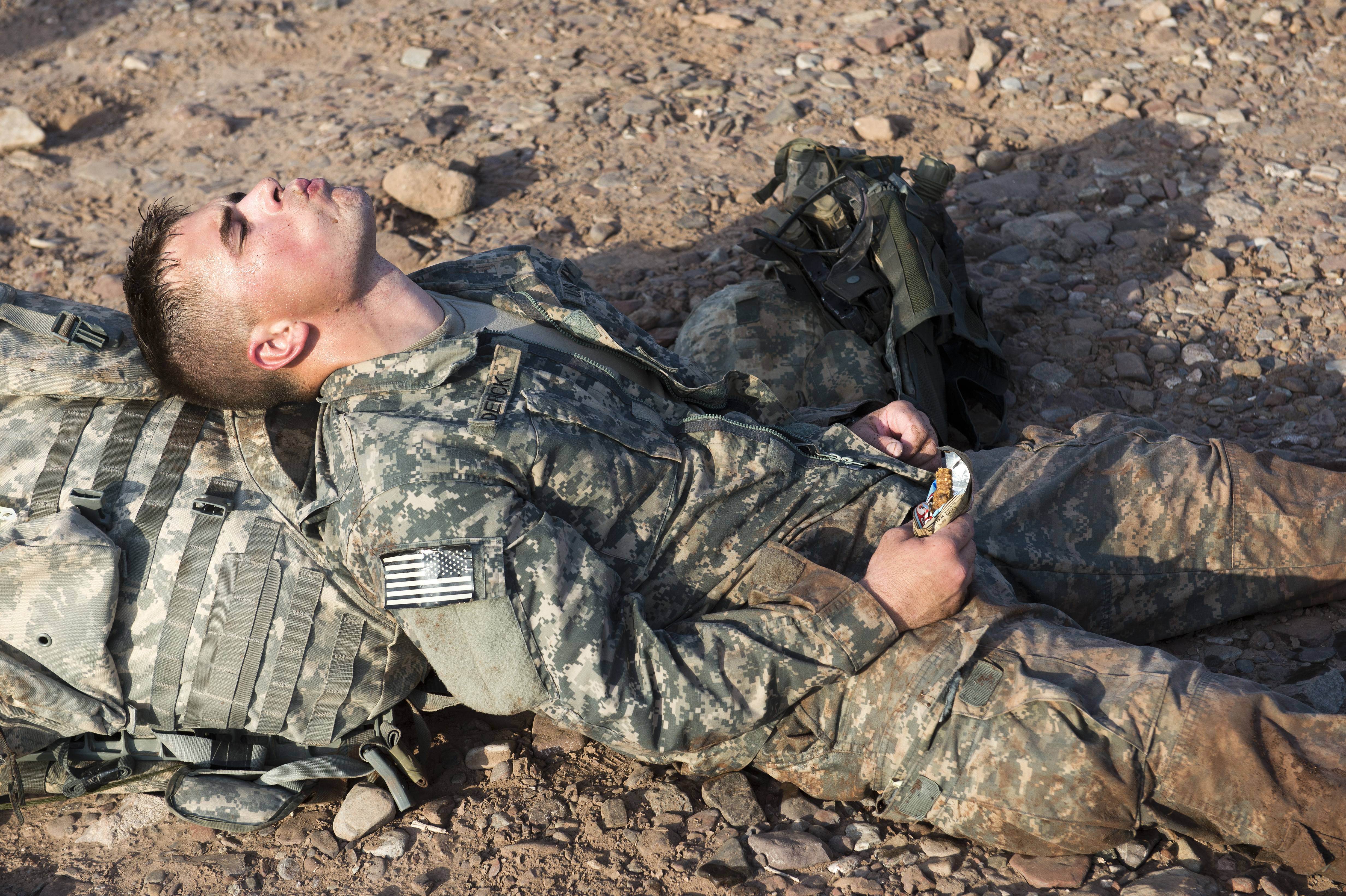 A soldier from the 1st Battalion, 77th Armor Regiment, rests after completing a 12-mile ruck march in Arta, Djibouti, April 24, 2015. The march was the final task for Expert Infantry Badge candidates to complete to earn the honor, which is one of the most important achievements a U.S. Army infantryman can earn. (U.S. Air Force photo by Staff Sgt. Nathan Maysonet)