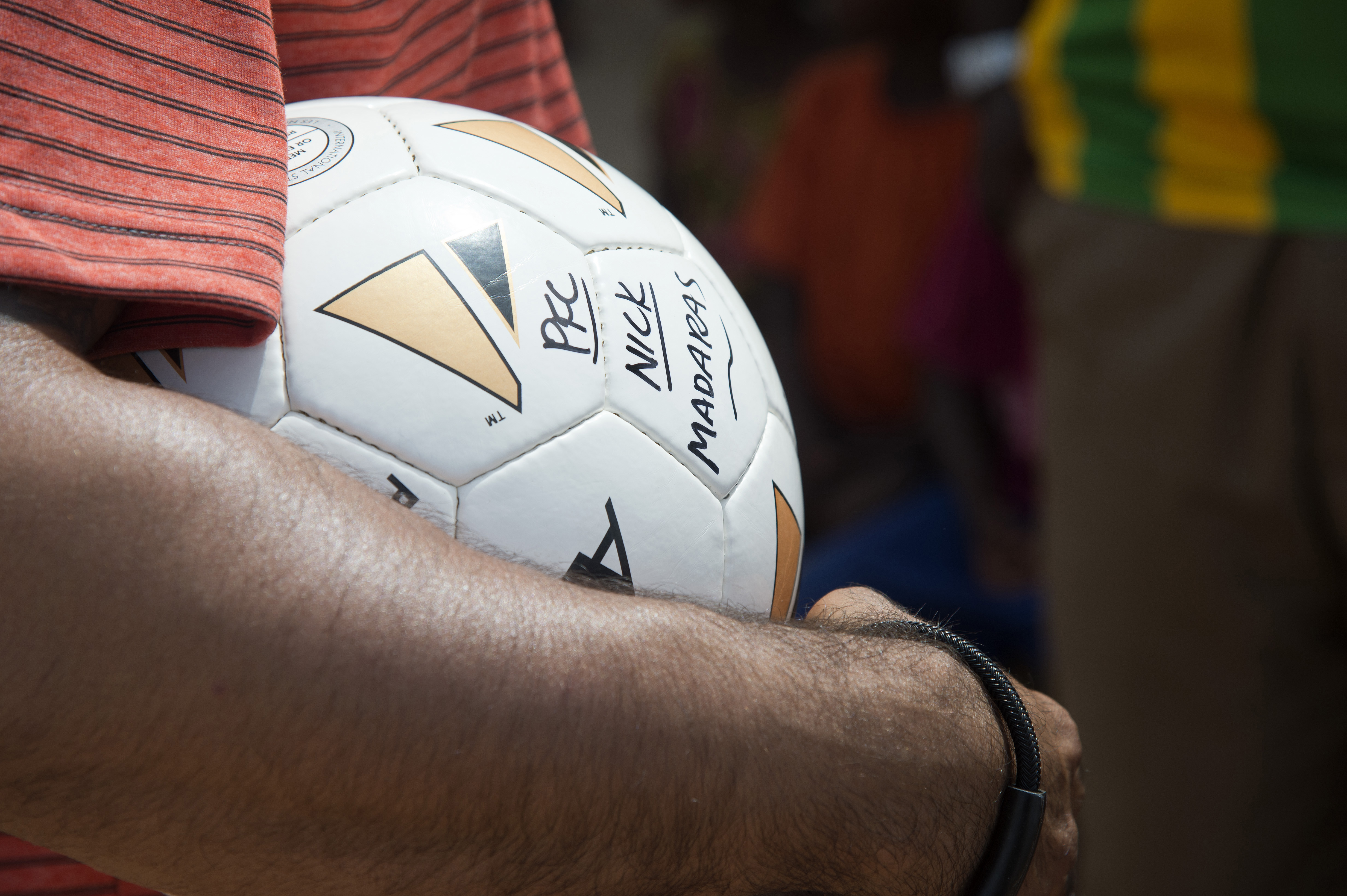 "Volunteers from Combined joint Task Force-Horn of Africa distribute soccer balls to children at Chebelley Village, Djibouti, May 21, 2015. The soccer balls were given to volunteers for distribution by the ""Kick for Nick"" charity, to honor the memory of U.S. Army Pvt. Nick Madaras. (U.S. Air Force photo by Staff Sgt. Nathan Maysonet)"