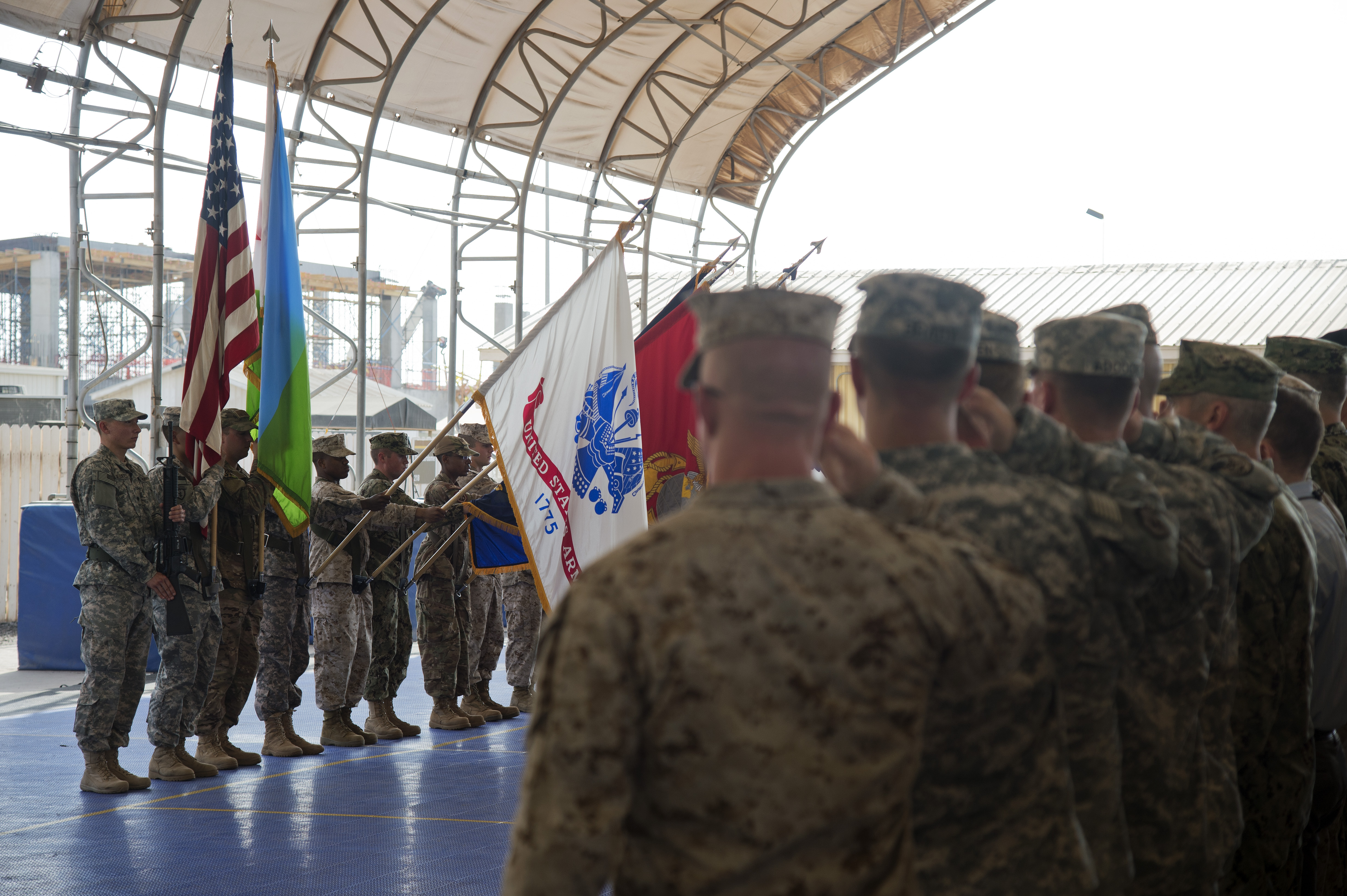 Service members salute the colors during a Memorial Day Ceremony at Combined Joint Task Force-Horn of Africa, Djibouti, May 25, 2015. (U.S. Air Force photo by Staff Sgt. Nathan Maysonet)
