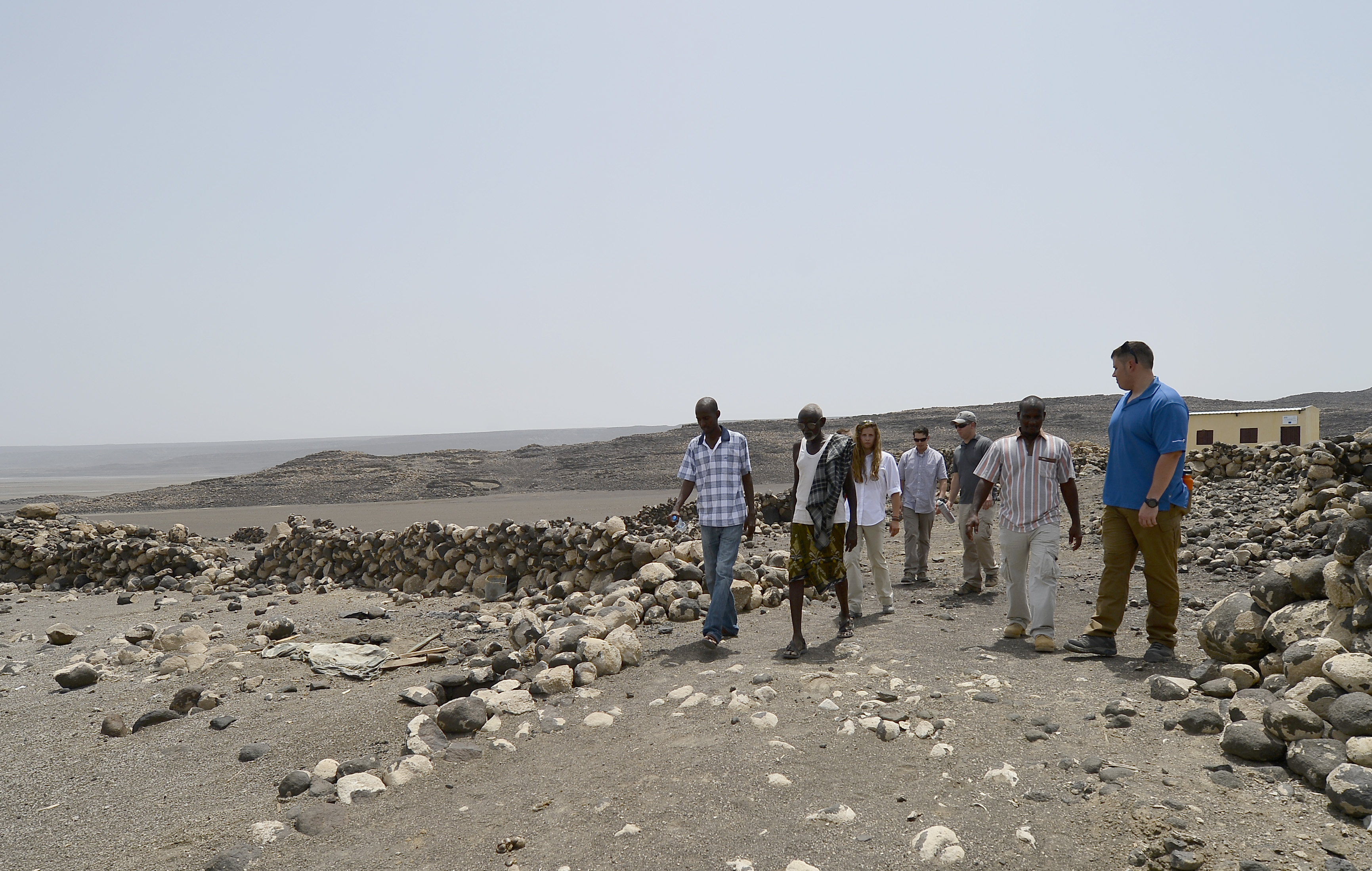 Salt Water Rest Stop village elders and members of the U.S. Army 404th Civil Affairs Battalion, assigned to Combined Joint Task Force- Horn of Africa, walk around Lake Abbé, Djibouti, May 20, 2015. Recurrent drought in the region has made life difficult for the herdsman, losing up to seventy percent of their livestock. Every few month volunteers drop off food and water to assist with malnourishment. (U.S. Air Force photo by Senior Airman Nesha Humes)