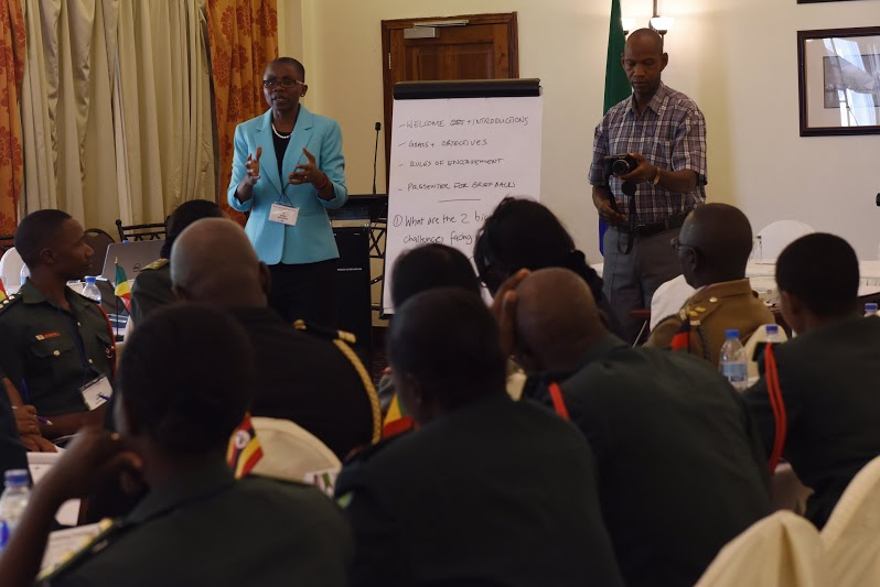 Monde Muyangwa, Woodrow Wilson Center's African Program director, leads a small group discussion during the Gender Mainstreaming Seminar in Arusha, Tanzania, May 19, 2015.  Military personnel and key leaders from U.S. Army Africa and African partner nations talked about the challenges they face when integrating positive gender positive change, while also discussing tangible solutions. (U.S. Air Force photo by Staff Sgt. Maria Bowman)