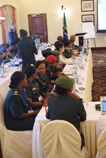 Military personnel and key leaders from African partner nations, U.S. Army Africa and Combined Joint Task Force-Horn of Africa listen to opening remarks at a Gender Mainstreaming seminar May 19, 2015 in Arusha, Tanzania.  The annual weeklong seminar covered three topics relating to equal opportunities for males and females, including integration resources, integration and leadership, and sexual gender-based violence.  (U.S. Air Force photo by Staff Sgt. Maria Bowman)