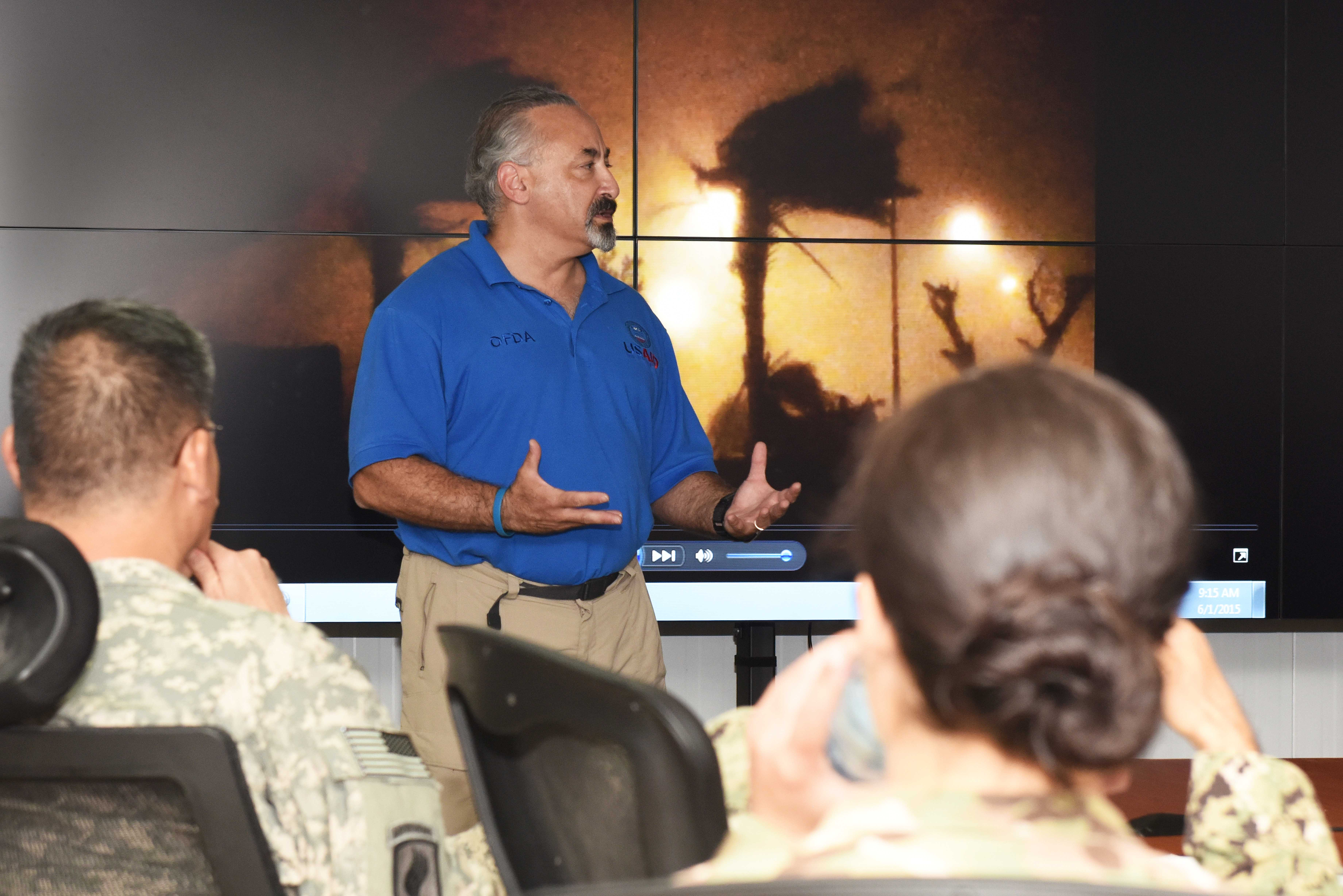 Steven Katz, Africa Command humanitarian assistance advisor instructs a joint humanitarian operations course at Camp Lemonnier, Djibouti June 1, 2015.  Course attendees learned about the relationship between USAID's Office of U.S. Foreign Disaster Assistance, its partners and the U.S. military, and learned about humanitarian assistance and disaster response operations.  (U.S. Air Force photo by Staff Sgt. Maria Bowman)