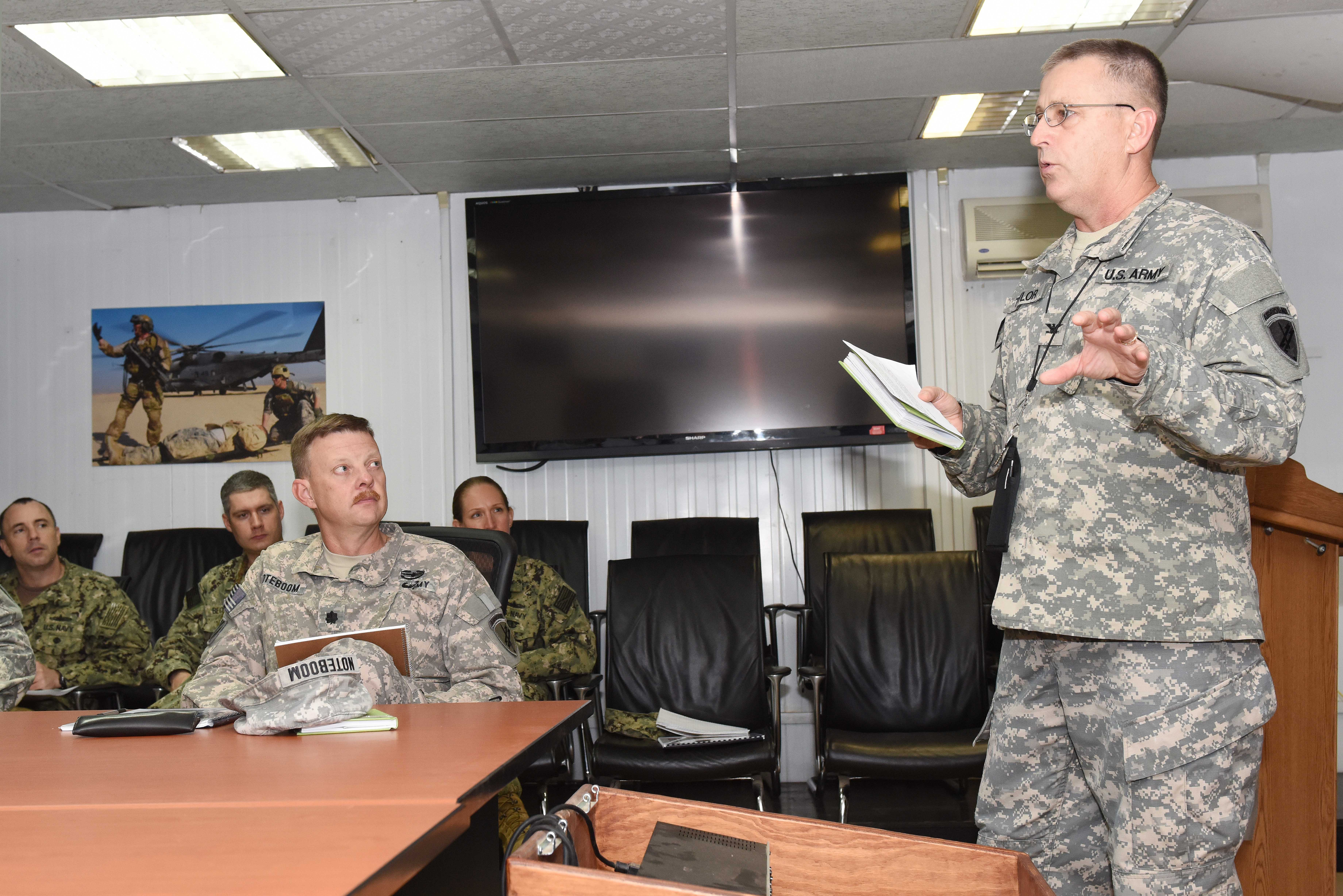 Col. Daniel Taylor, 357th Theater Security Cooperation Fusion Action Cell director, gives opening remarks during a joint humanitarian operations course at Camp Lemonnier, Djibouti, June 1, 2015.  Course attendees learned about the international disaster response system and the U.S. civilian and military responsibilities. (U.S. Air Force photo by Staff Sgt. Maria Bowman)