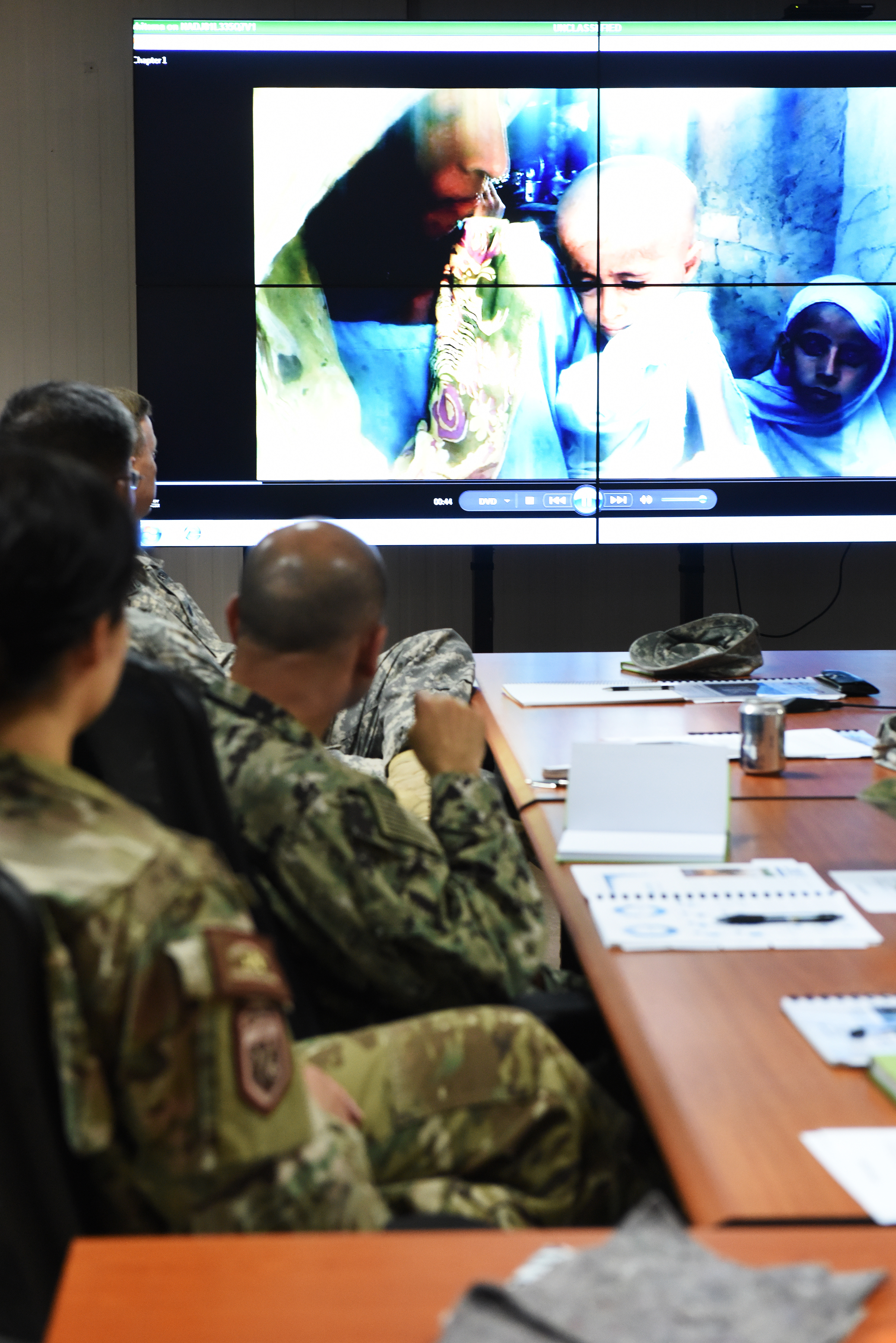 Combined Joint Task Force-Horn of Africa service members assigned to Camp Lemonnier watch a USAID's Office of U.S. Foreign Disaster Assistance introductory video during a joint humanitarian operations course June 1, 2015.  The JHOC course attendees learned about mutual coordination and cooperation between the U.S. Government civilian agencies and the U.S. military, including best practices and lessons learned.  (U.S. Air Force photo by Staff Sgt. Maria Bowman)