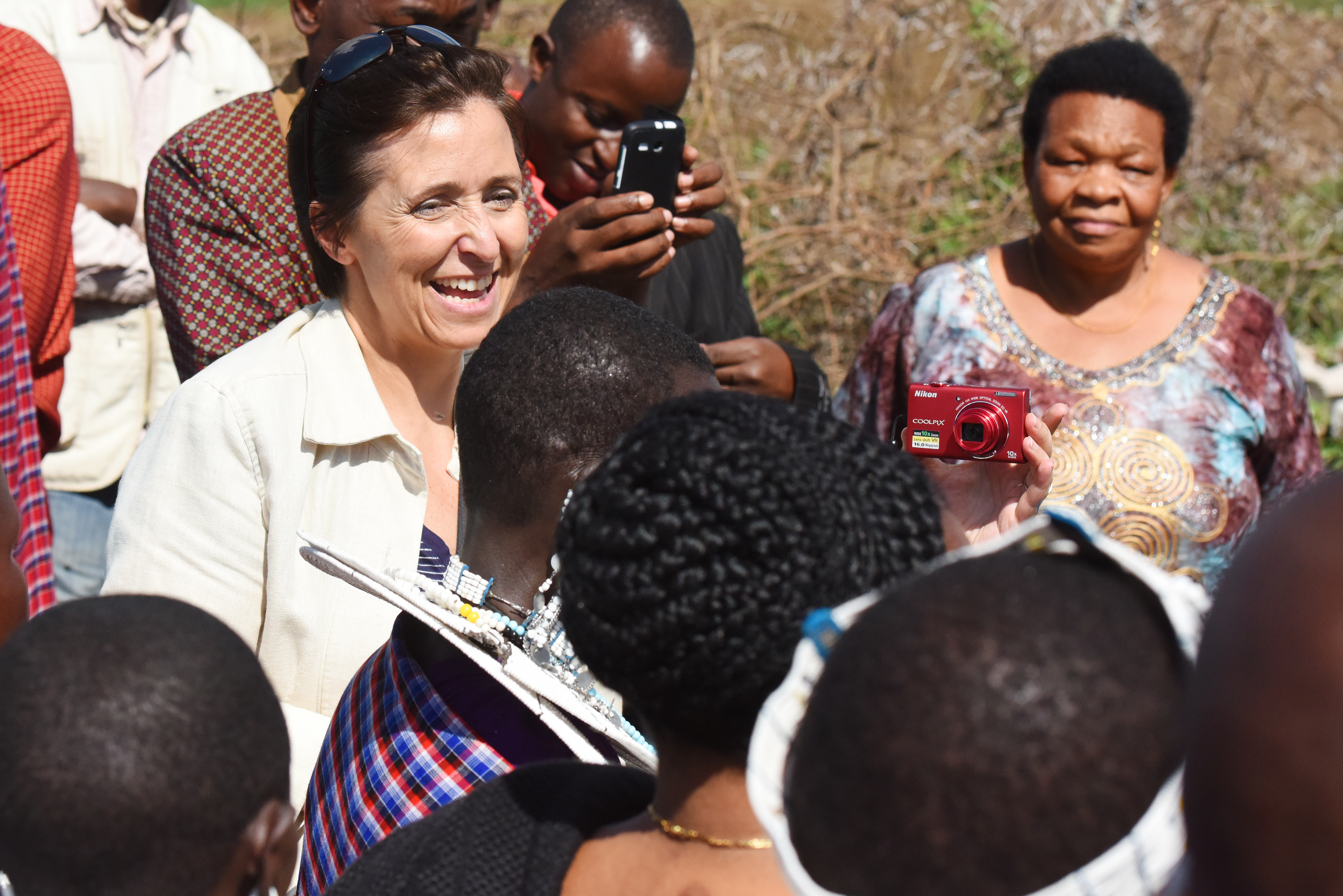 U.S. Navy Cmdr. Kimberly Walz, Combined Joint Task Force-Horn of Africa Theater Security Cooperation deputy director, interacts with Maasai Tribe members during the Gender Mainstreaming Seminar cultural day May 21, 2015 in Tanzania.  The tribe welcomed their visitors with singing and dancing.  (U.S. Air Force photo by Staff Sgt. Maria Bowman)