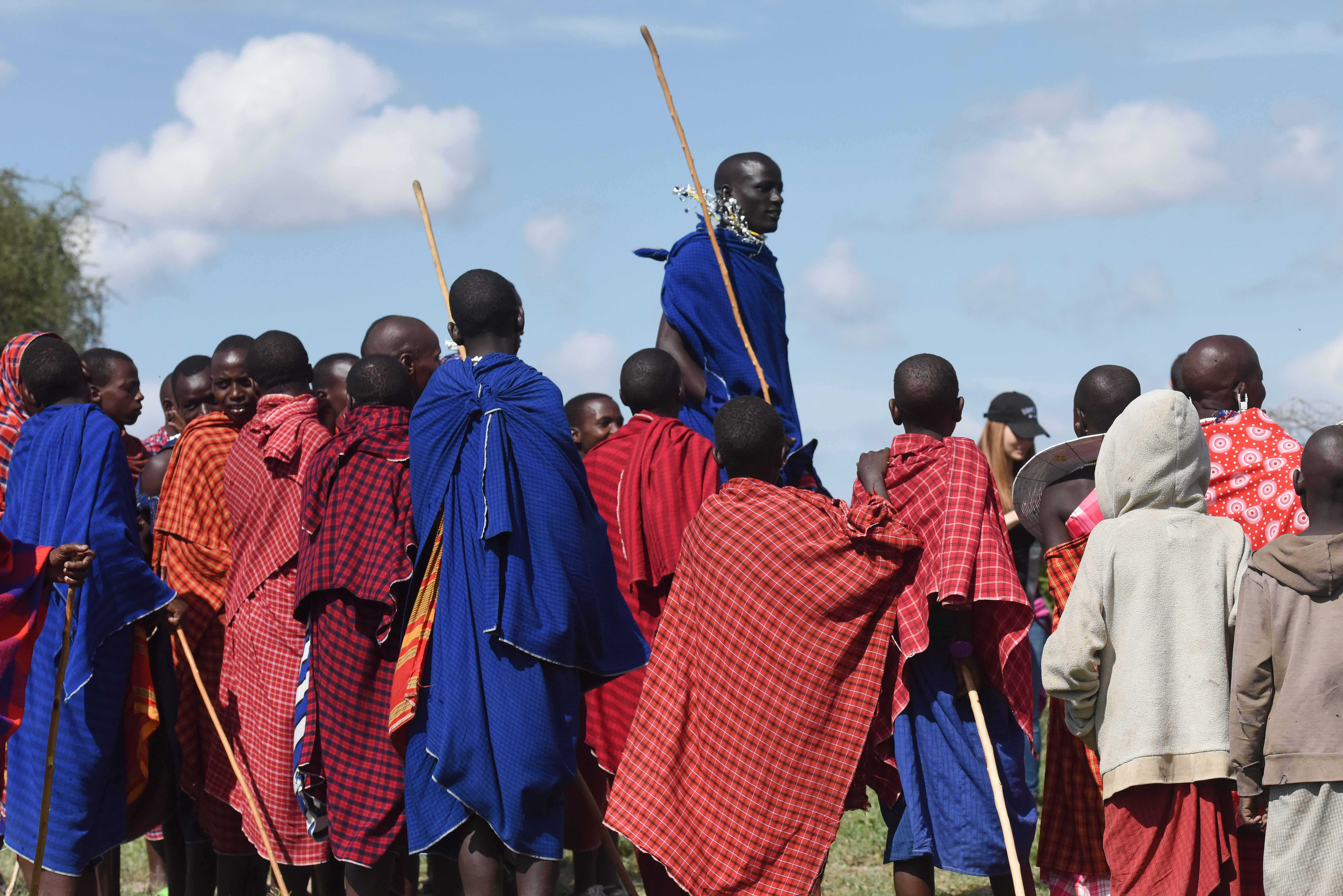 Maasai Tribe members put on a dance performance for the visitors from the Gender Mainstreaming seminar, during their culture day May 21, 2015.  The Massai tribe is a group of semi-nomadic people inhabiting southern Kenya and northern Tanzania.  (U.S. Air Force photo by Staff Sgt. Maria Bowman)