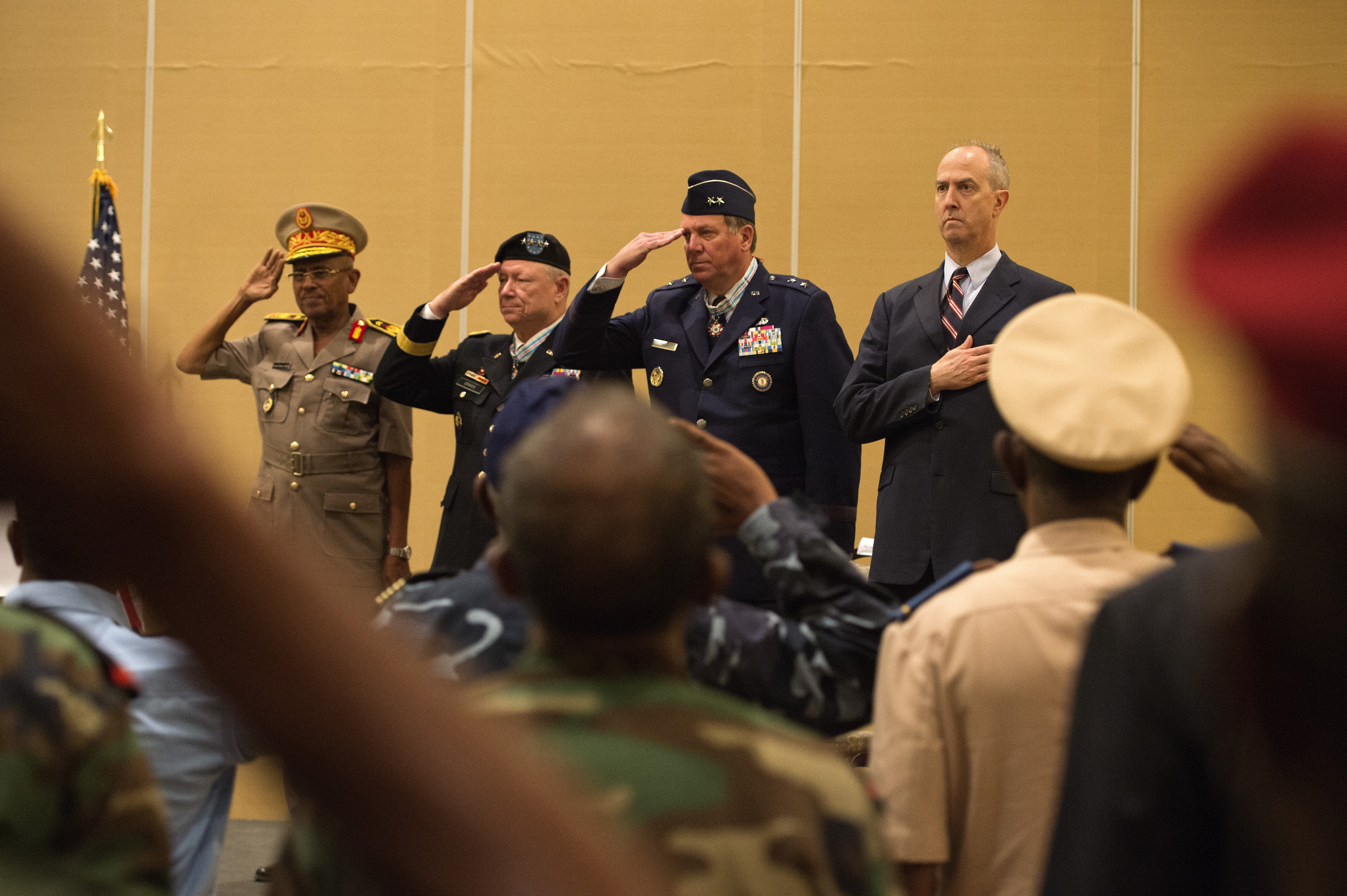 From left, Maj. Gen. Zakaria Cheik Ibrahim, Djiboutian Armed Forces chief of defense, National Guard Bureau Joint Chief of Staff Gen. Frank Grass, Maj. Gen. Edward Tonini, Kentucky National Guard adjutant general and U.S. Ambassador to Djibouti Thomas Kelly, stand during the American and Djiboutian national anthems during the Kentucky National Guard and the Republic of Djibouti State Partnership Program signing ceremony at the Kempinski Hotel, Djibouti, June 2, 2015. The SPP provides host countries with a skilled force capable of helping to train and develop the host nation's defenses and security, disaster response, crisis management, and interagency cooperation. (U.S. Air Force photo by Staff Sgt. Nathan Maysonet)