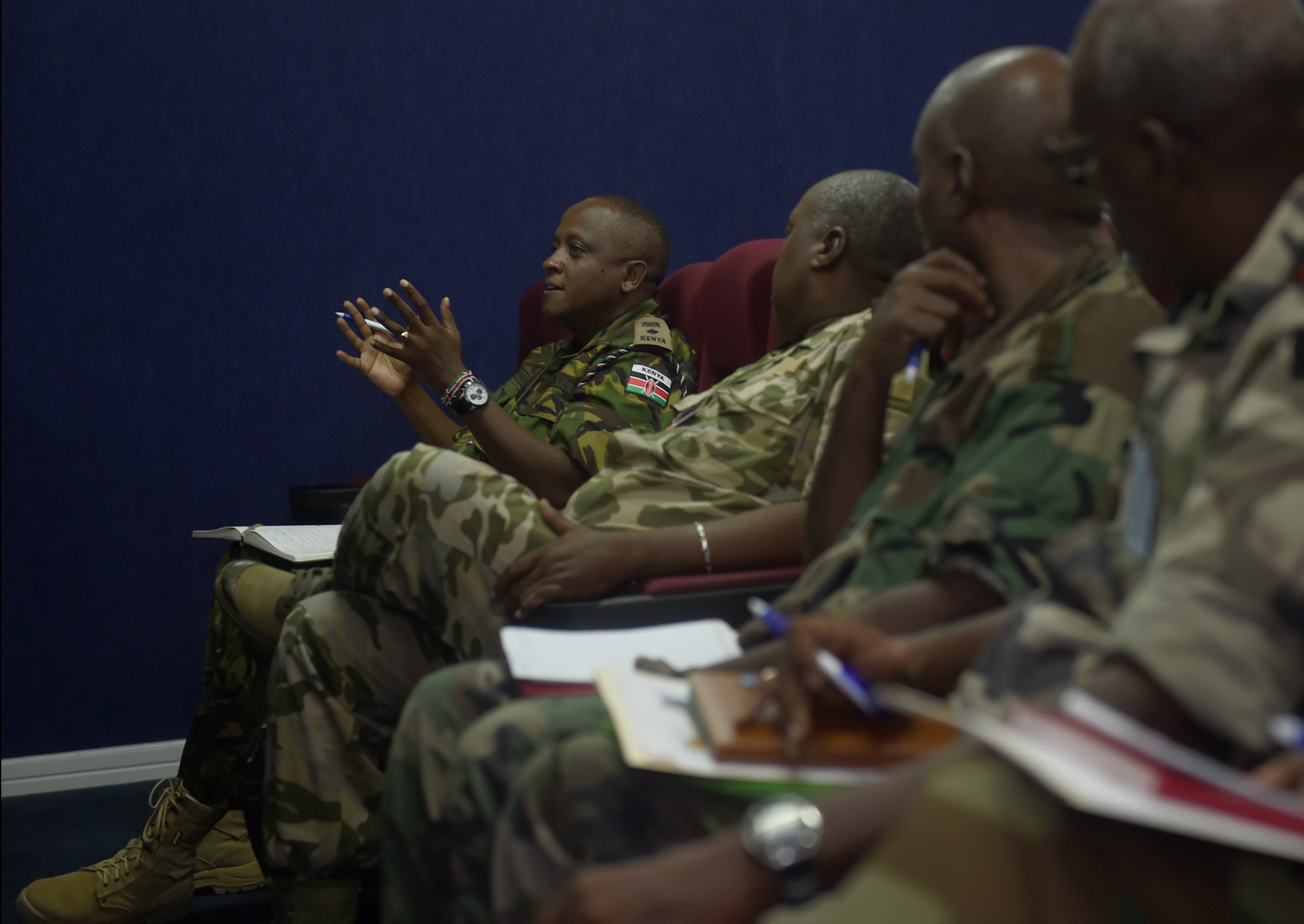 Lt. Col. Paul Njuguna Muiru, African Union Mission in Somalia force spokesperson, asks a question during a Combined Joint Task Force–Horn of Africa Public Information Officer Conference at Camp Lemonnier, Djibouti, June 2, 2015. Twenty-eight military public information officers met together to collaborate and discuss public affairs strategic communication and information operations.