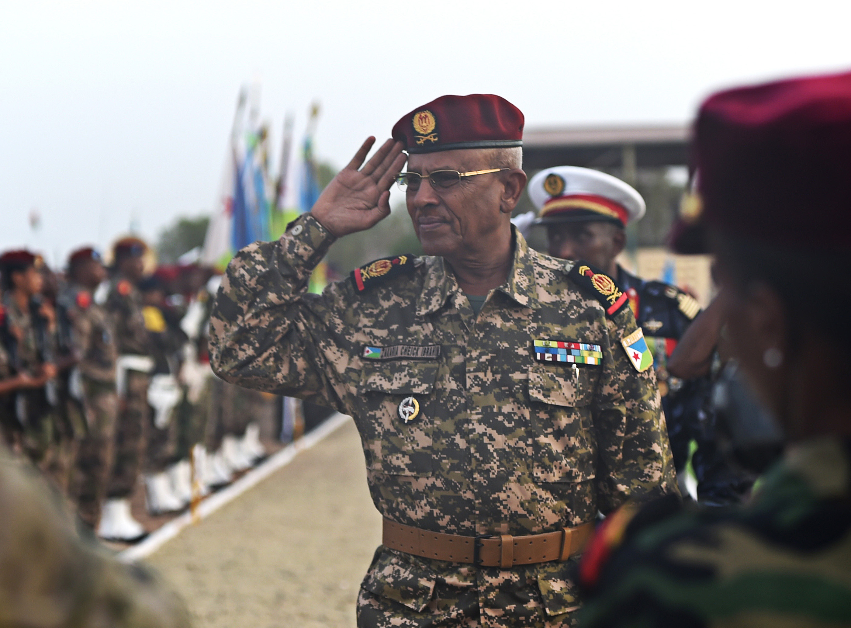 Gen. Zakaria Cheikh Ibrahim, Djiboutian Armed Forces (FAD) chief of defense, salutes his troops during the FAD's 38th anniversary celebration at Camp Cheik Osman, Djibouti, June 6, 2015.  Zakaria gained command in 2013 and is responsible for 6500 Djiboutian military personnel. (U.S. Air Force photo by Senior Airman Nesha Humes)