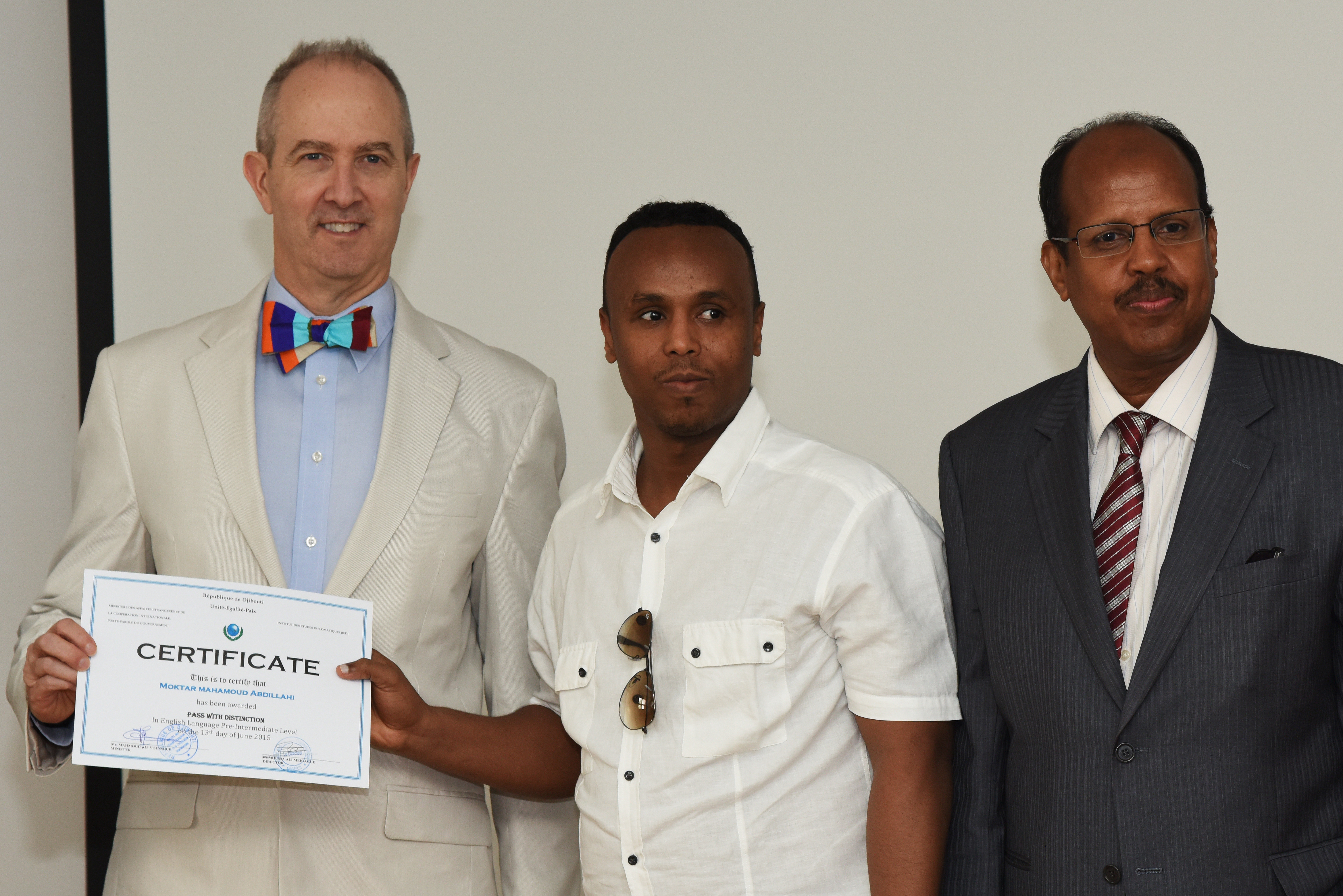 Moktar Mahamoud (middle), an English student, receives his graduation certificate from Tom Kelly (left), U.S. Ambassador to Djibouti and Mahmoud Ali Youssouf (right), Djibouti Minister of Foreign Affairs and International Cooperation.  Moktar recently went to the U.S., where he used his new English skills.  (U.S. Air Force photo by Staff Sgt. Maria Bowman)