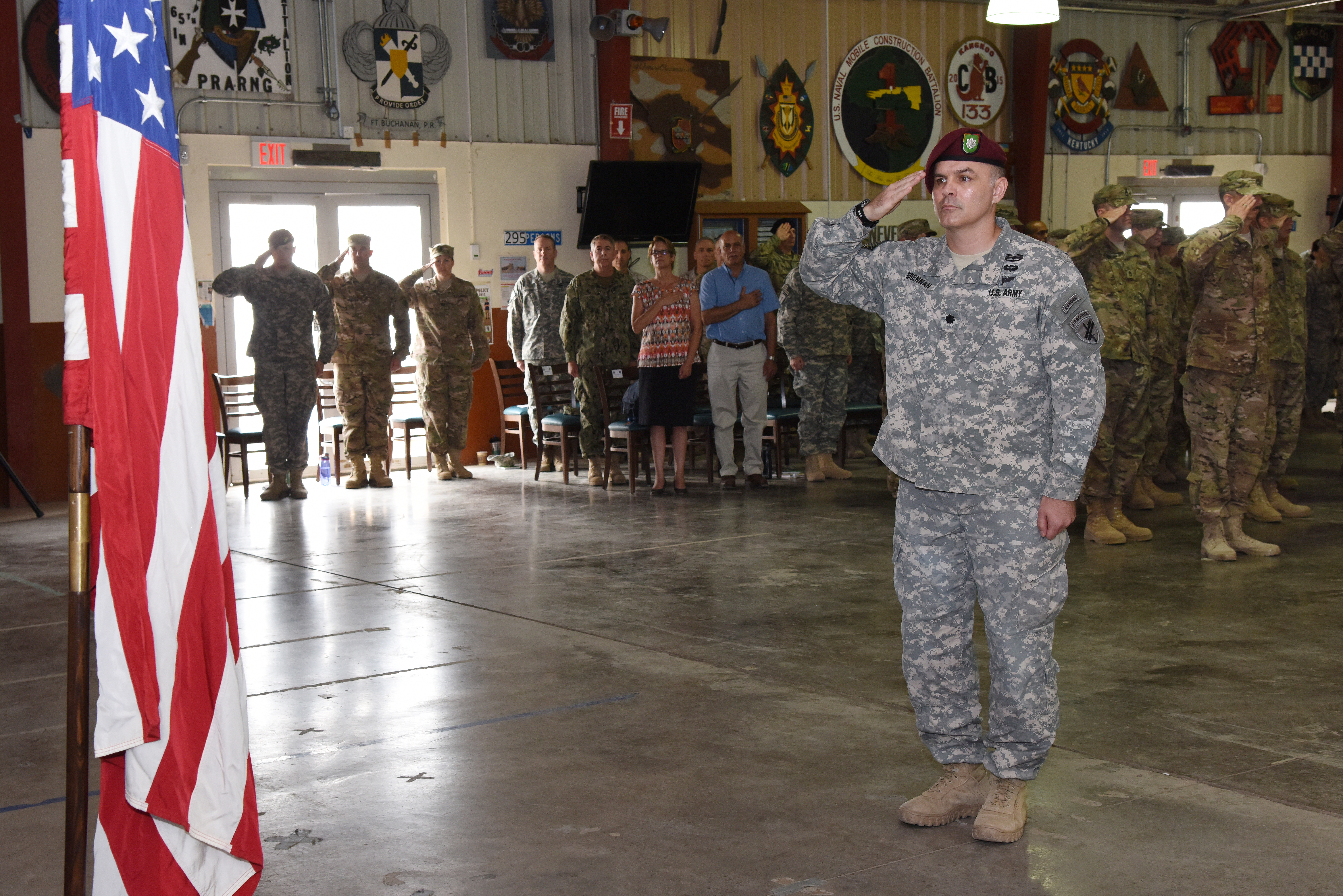 U.S. Army Lt. Col. Timothy Brennan, 404th Civil Affairs Battalion commander, renders a salute during the playing of the National Anthem at a transfer of authority ceremony June 22, 2015, at Camp Lemonnier, Djibouti.  The ceremony signified the transfer of authority from the out-going unit to the incoming unit.  (U.S. Air Force photo by Staff Sgt. Maria Bowman)
