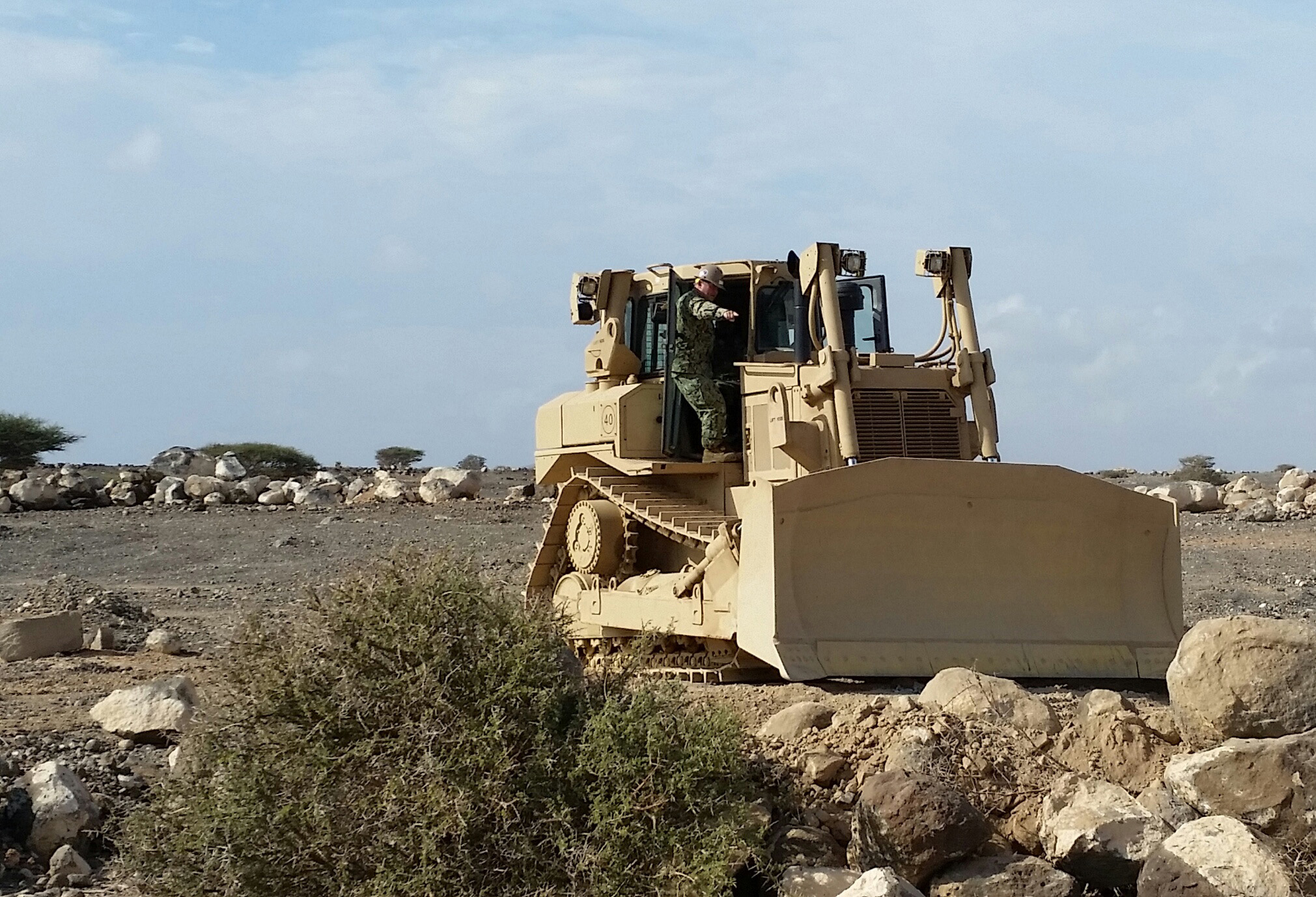 Camp Lemonnier , Djibouti (Mar. 24, 2015) U.S. Navy Petty Officer 1st  Class David Graydon and  U.S Navy Petty Officer 3rd Class Brandon Paul, equipment operators with Naval Mobile Construction Battalion (NMCB) 14  train Djiboutian Army's Construction Engineers on a new D7 Dozer during a U.S. Army-led training evolution. NMCB-14 Detachment HOA is deployed to Camp Lemonnier in support of Combined Joint Task Force–Horn of Africa. (U.S. Navy photo by Petty Officer 1st Class Kevin Haneberg)