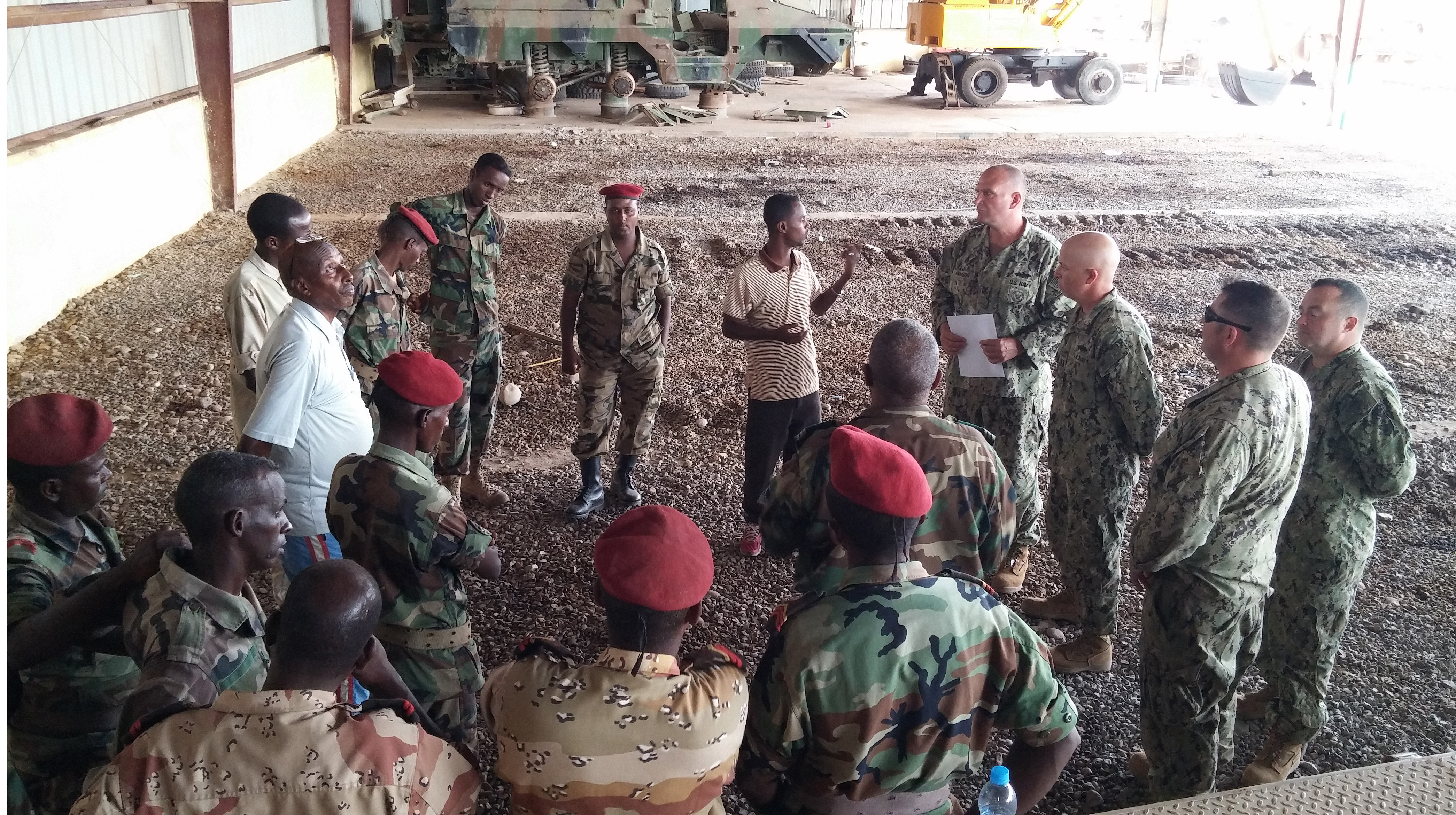 Camp Cheik Osman, Djibouti  (Mar. 18, 2015) U.S. Navy Seabees of Naval Mobile Construction Battalion (NMCB) 14, along with members of the Djiboutian Army's Construction Engineers, discuss safety topics before beginning hands-on equipment operation training. Naval Mobile Construction Battalion -14 Detachment HOA is assigned to Camp Lemonnier in support of Combined Joint Task Force–Horn of Africa. (U.S. Navy photo by Lieutenant Junior Grade Stephen Woodham)