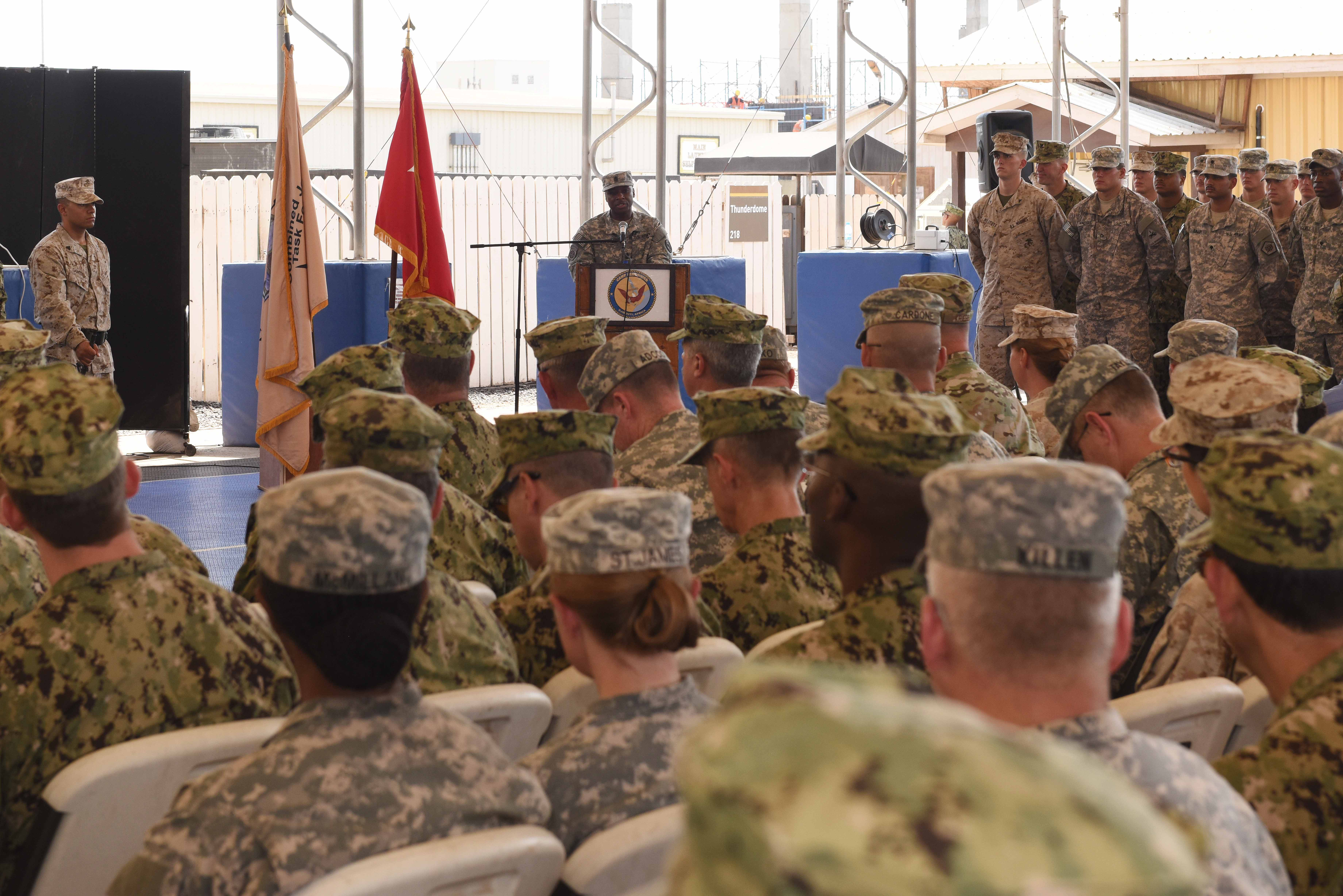 U.S. Army Sgt. Maj. Claudell Taylor speaks with service members assigned to Camp Lemonnier, Djibouti during a relinquishment of authority ceremony when he took over on May 16, 2015.  During his six weeks as interim command senior enlisted leader, ending June 19, 2015, he served as the principle advisor to the Combined Joint Task Force-Horn of Africa commander, and was responsible for issues affecting health, morale, welfare and professional development for more than 1,800 Army, Navy, Air Force and Marines joint service personnel in 14 African countries.  (U.S. Air Force photo by Staff Sgt. Maria Bowman)