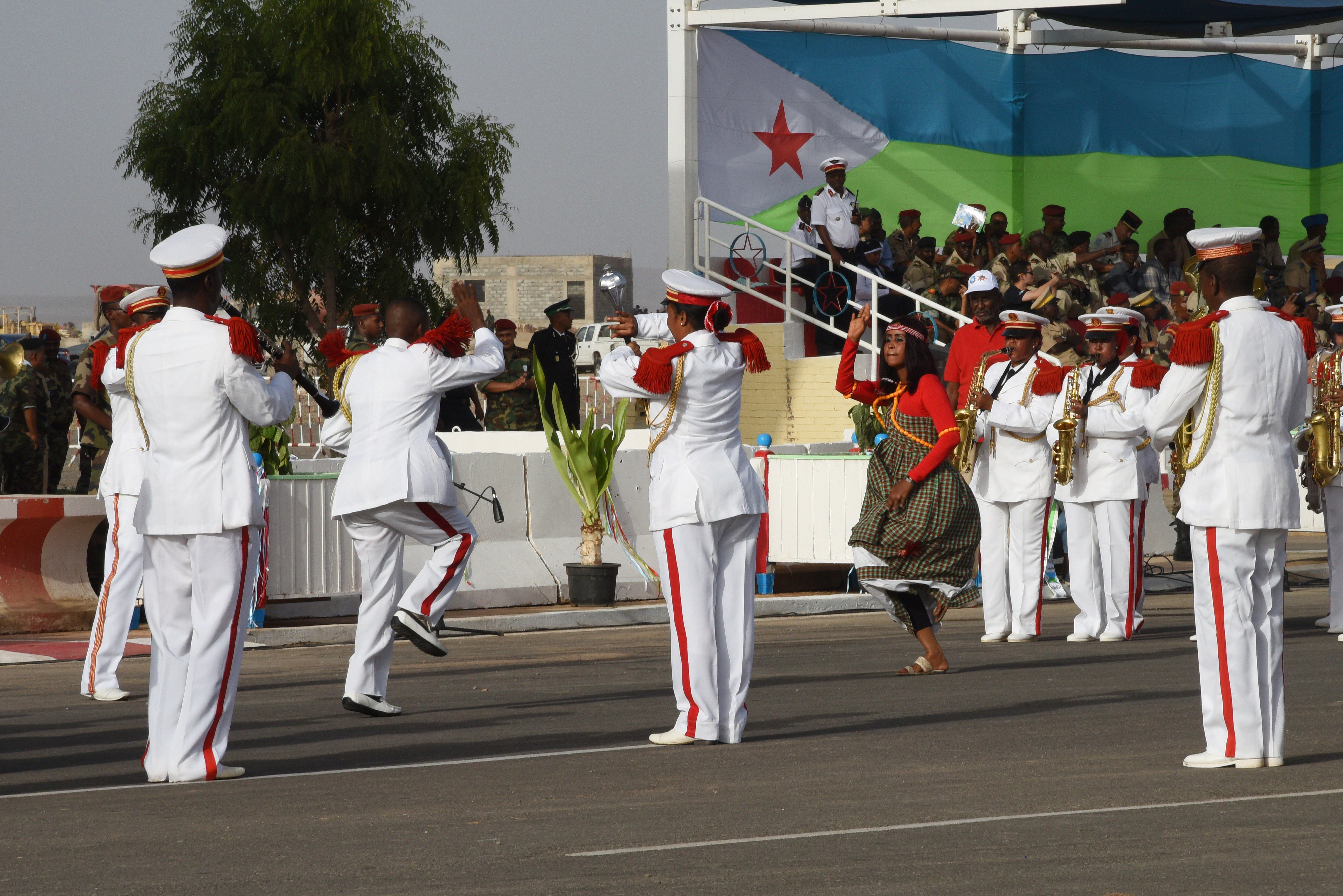 Marching band members play music and dance during a Djibouti independence day celebration June 27, 2015, commemorating the 38th anniversary of Djibouti becoming a sovereign nation. Djibouti's military, law enforcement and civil servants marched along the parade route, while the band played festive songs.  (U.S. Air Force photos by Staff Sgt. Maria Bowman)