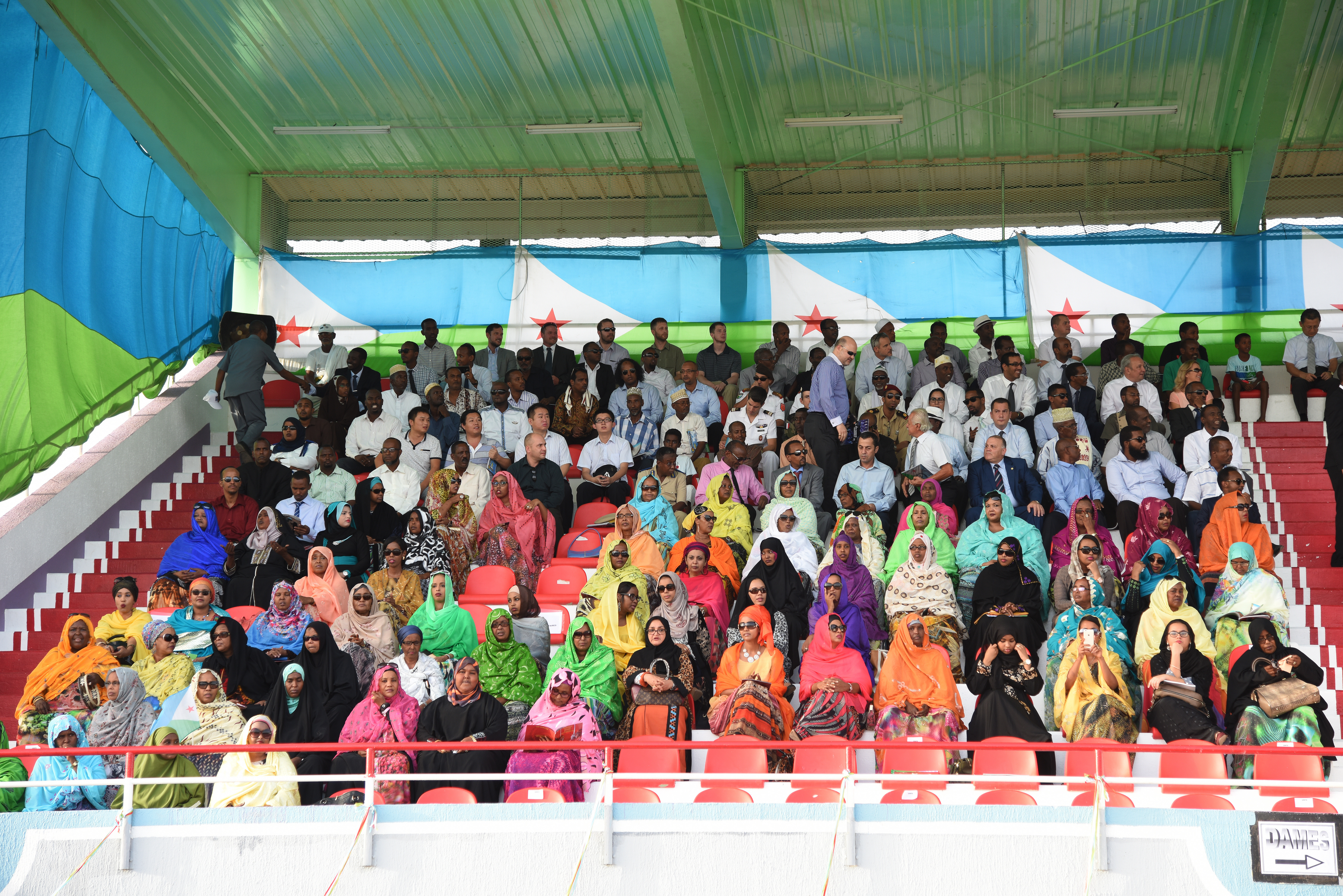 Djiboutian citizens attend an independence day celebration June 27, 2015, commemorating the 38th anniversary of Djibouti declaring its emancipation from France.  The military parade included a marching band and troops showcasing its different military equipment.  (U.S. Air Force photo by Staff Sgt. Maria Bowman)