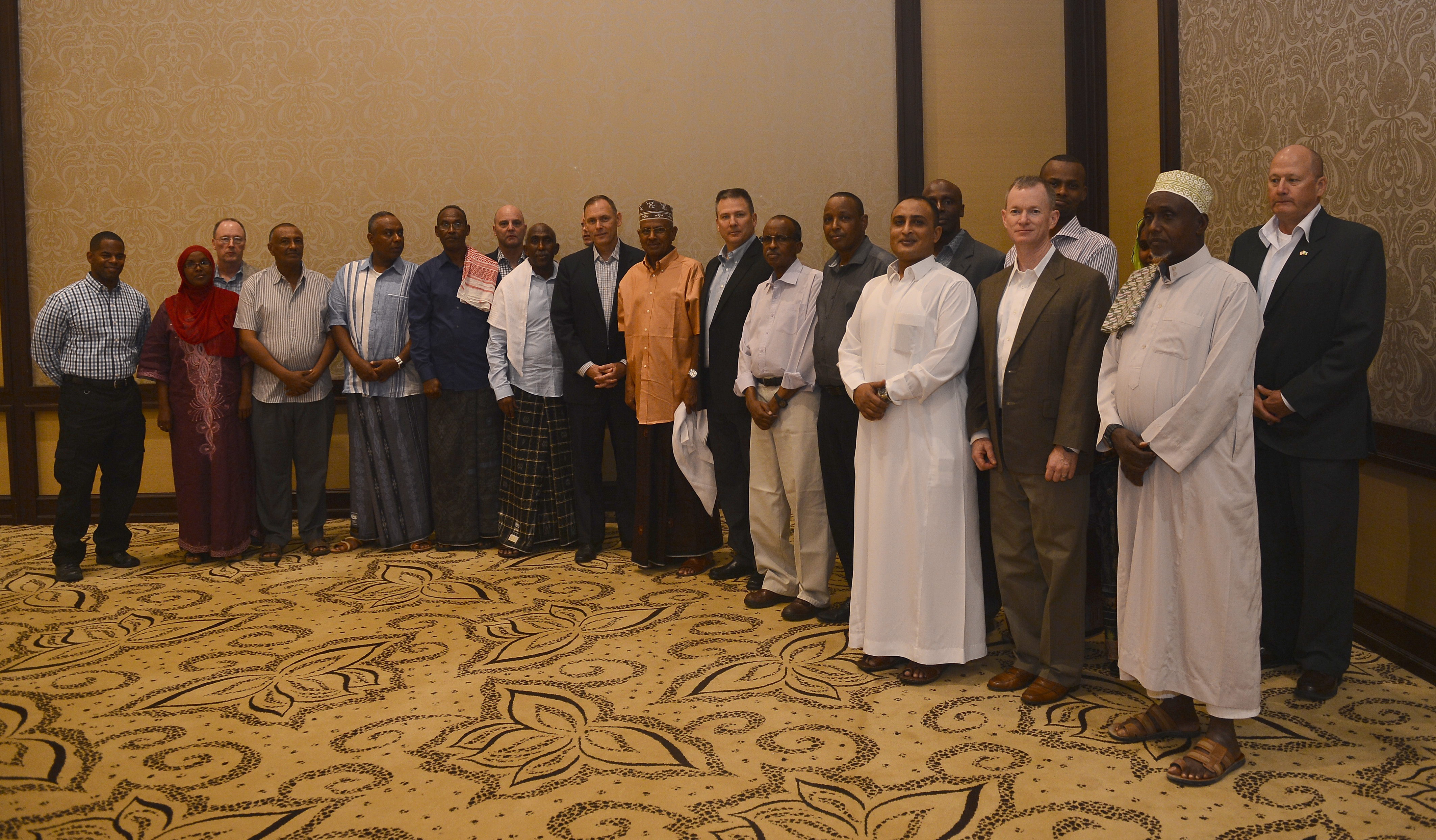 Combined Joint Task Force-Horn of Africa's Iftar dinner attendees pose for a group photo at the Kempinski Hotel, Djibouti, June 29, 2015. CJTF-HOA, Camp Lemonnier, and U.S. Embassy leaders gathered together with Djiboutian military leaders and their families in honor of Ramadan. (U.S. Air Force photo by Senior Airman Nesha Humes)
