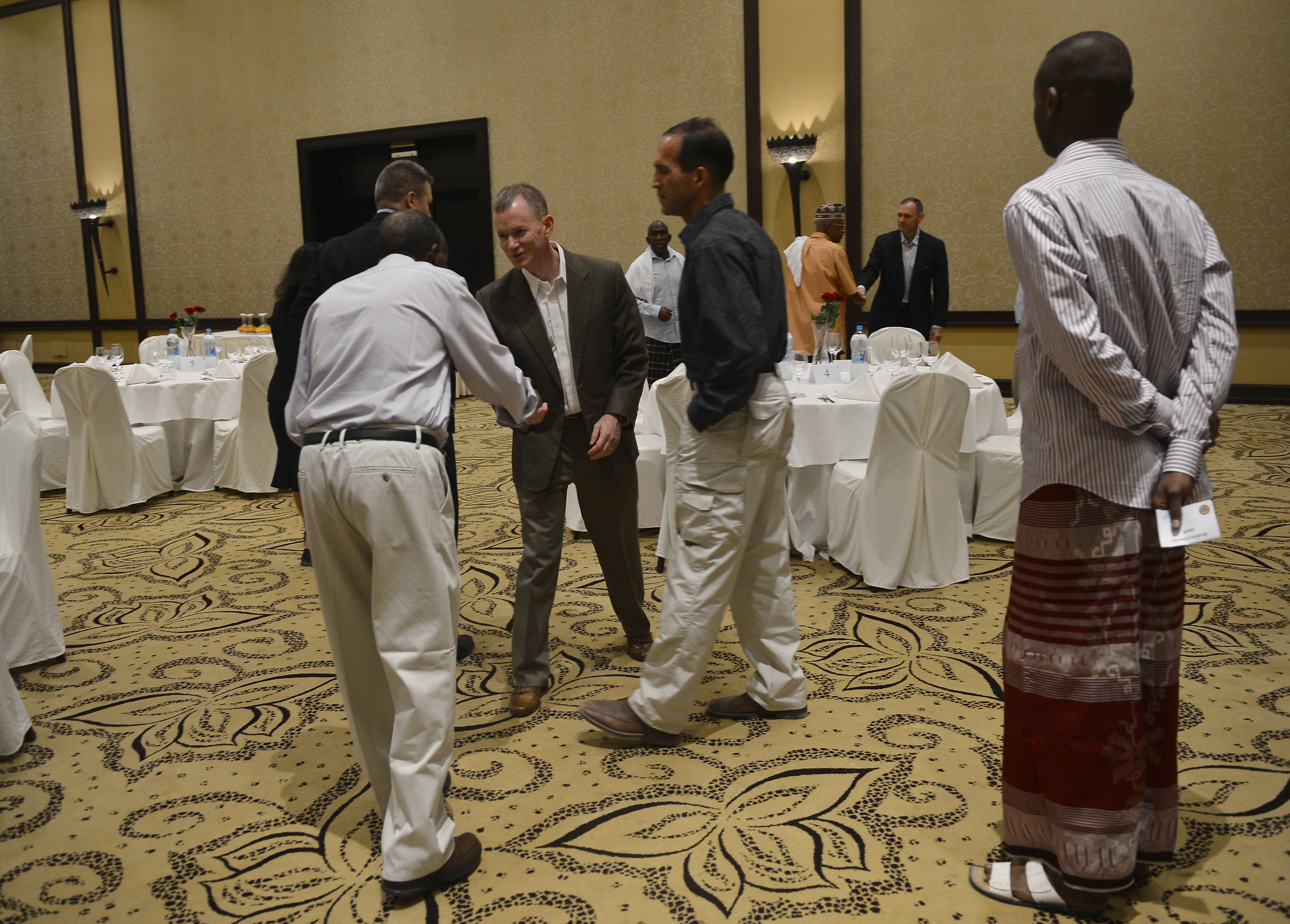 U.S. Air Force Brig. Gen. William P. West, Combined Joint Task Force-Horn of Africa deputy commander, greets Iftar dinner guests at the Kempinski Hotel, Djibouti, June 29, 2015. Since 2006, CJTF-HOA, Camp Lemonnier, and U.S. Embassy leaders have gathered with Djiboutian military leaders and their families for the annual celebration of the month-long Ramadan fasting. (U.S. Air Force photo by Senior Airman Nesha Humes)