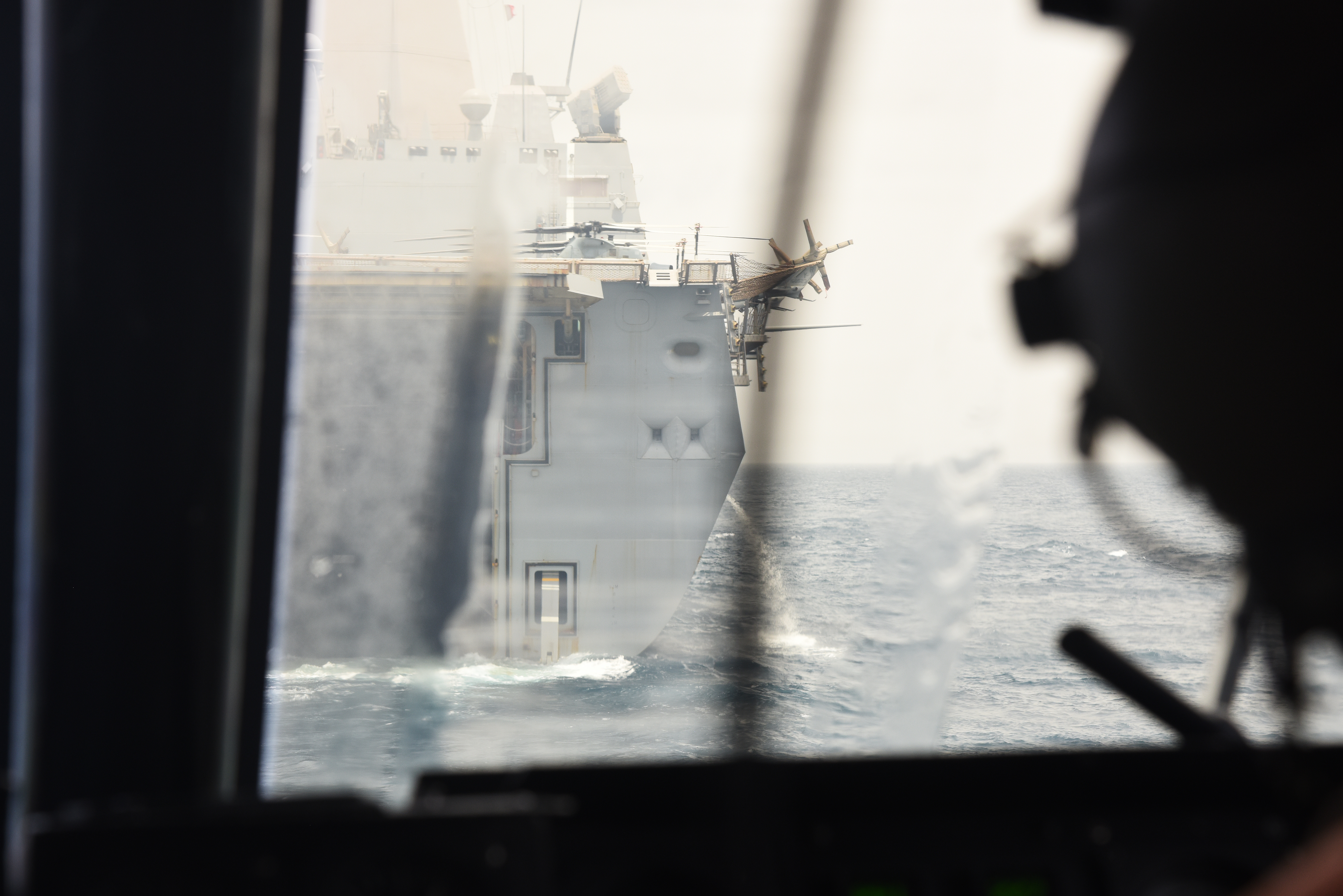A U.S. Navy Landing Craft Air Cushion (LCAC) approaches USS Anchorage in Arta, Djibouti, July 20, 2015. USS Anchorage is a transport dock ship, and is designed to transport and land elements of a landing force for expeditionary warfare missions.  (U.S. Air Force photo by Staff Sgt. Maria Bowman)