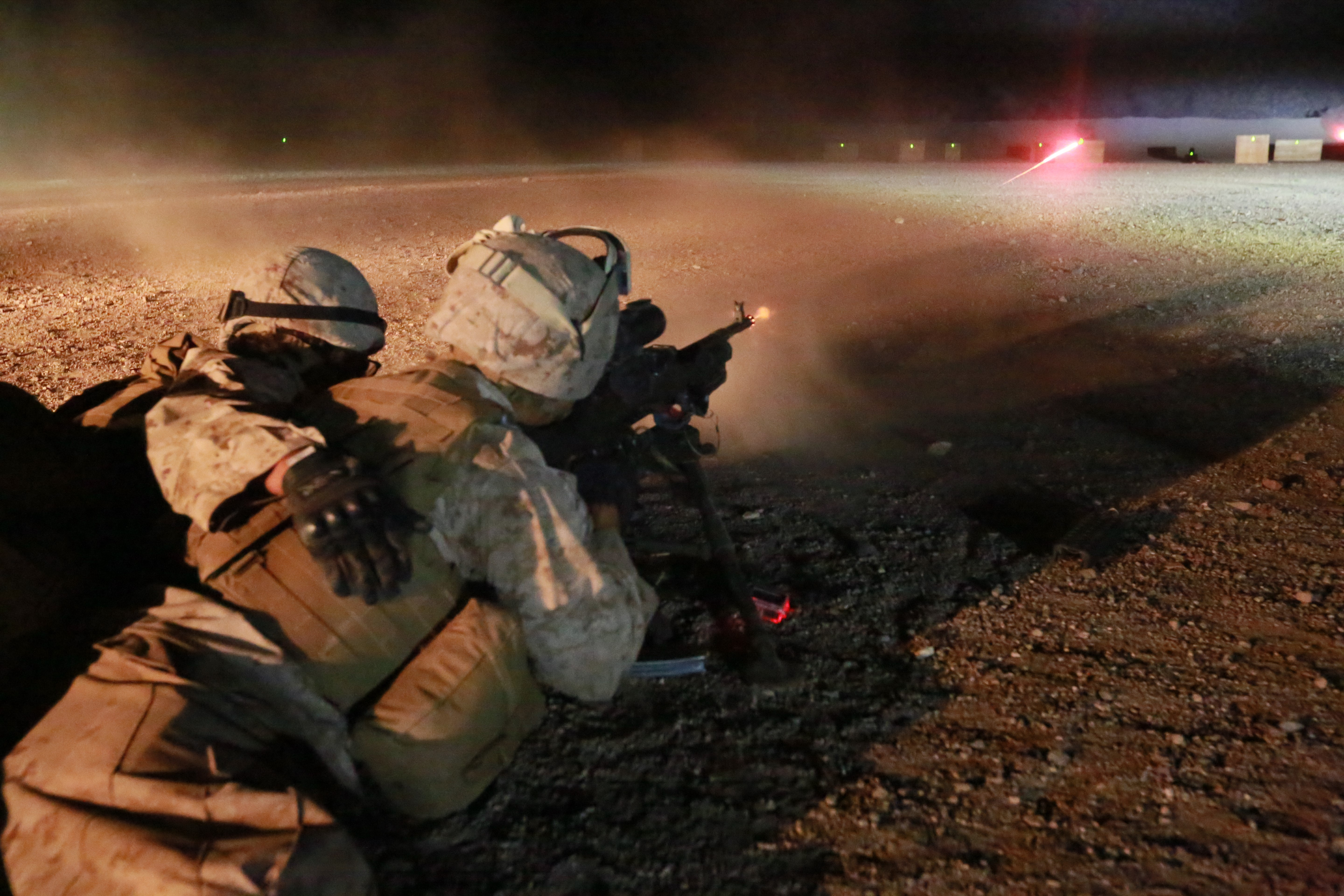150722-M-TJ275-167 ARTA BEACH, Djibouti (July 22, 2015) U.S. Marine Lance Cpl. Zachary Palacio engages his target with an M240B squad automatic weapon during machine gun sustainment training. Palacio is a motor transport operator with Combat Logistics Battalion 15, 15th Marine Expeditionary Unit. Elements of the 15th Marine Expeditionary Unit are ashore in Djibouti for sustainment training to maintain and enhance the skills they developed during their pre-deployment training period.  The 15th MEU is currently deployed in support of maritime security operations and theater security cooperation efforts in the U.S. 5th and 6th Fleet areas of operation (U.S. Marine Corps photo by Sgt. Steve H. Lopez/Released)