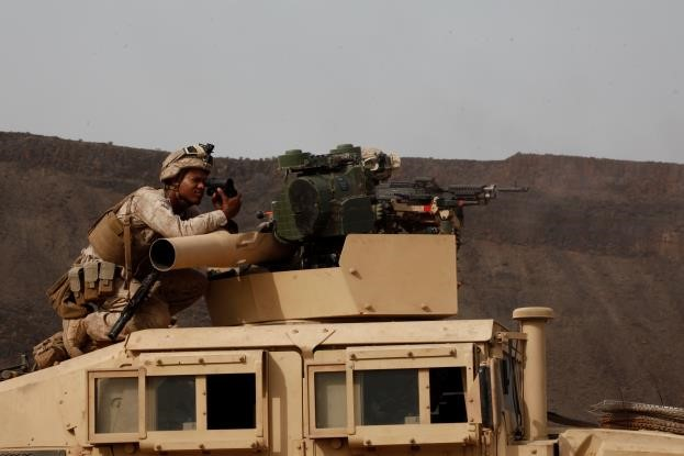 150726-M-ZZ999-041   ARTA BEACH, Djibouti (July 28, 2015) U.S. Marine Cpl. Tyrone Watkins observes the impact area as Marines fire at targets simulating tanks. Watkins is a vehicle commander with Combined Anti-Armor Team 1, Weapons Company, Battalion Landing Team 3rd Battalion, 1st Marine Regiment, 15th Marine Expeditionary Unit. Elements of the 15th MEU are ashore in Djibouti for sustainment training to maintain and enhance the skills they developed during their pre-deployment training period. The 15th MEU is currently deployed in support of maritime security operations and theater security cooperation efforts in the U.S. 5th and 6th Fleet areas of operation. (U.S. Marine Corps photo by Gunnery Sgt. Eddy Arce/Released)