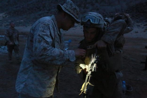 150726-M-ZZ999-148   ARTA BEACH, Djibouti (July 26, 2015) U.S. Marine Gunnery Sgt. Michael Ramirez, left, ensures Lance Cpl. George Camden weapon is free of rounds after establishing a battle-sight zero. Ramirez is a platoon sergeant and Camden is a vehicle driver, both with Combined Anti-Armor Team 1, Weapons Company, Battalion Landing Team 3rd Battalion, 1st Marine Regiment, 15th Marine Expeditionary Unit. Elements of the 15th MEU are ashore in Djibouti for sustainment training to maintain and enhance the skills they developed during their pre-deployment training period. The 15th MEU is currently deployed in support of maritime security operations and theater security cooperation efforts in the U.S. 5th and 6th Fleet areas of operation. (U.S. Marine Corps photo by Gunnery Sgt. Eddy Arce/Released)