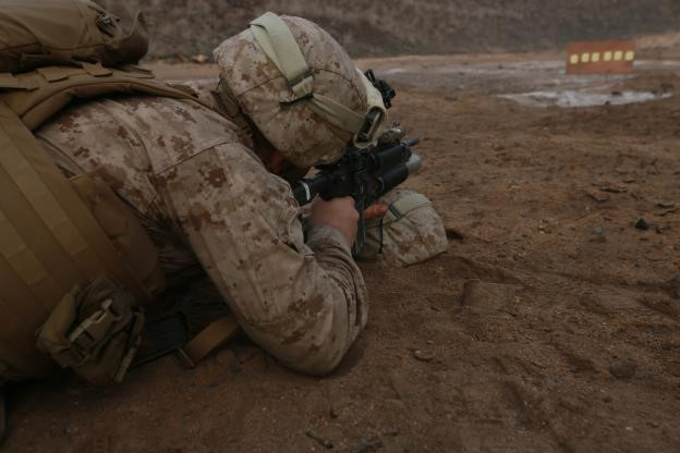 150726-M-ZZ999-052   ARTA BEACH, Djibouti (July 26, 2015) U.S. Marine Cpl. Daniel Molina establishes a battle-sight zero with his M4 carbine. Molina is a vehicle commander with Combined Anti-Armor Team 1, Weapons Company, Battalion Landing Team 3rd Battalion, 1st Marine Regiment, 15th Marine Expeditionary Unit. Elements of the 15th MEU are ashore in Djibouti for sustainment training to maintain and enhance the skills they developed during their pre-deployment training period. The 15th MEU is currently deployed in support of maritime security operations and theater security cooperation efforts in the U.S. 5th and 6th Fleet areas of operation. (U.S. Marine Corps photo by Gunnery Sgt. Eddy Arce/Released)