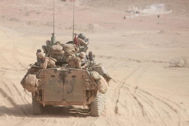 150729-M-TJ275-030   ARTA BEACH, Djibouti (July 29, 2015) U.S. Marines with Light Armored Reconnaissance Detachment, Battalion Landing Team 3rd Battalion, 1st Marine Regiment, 15th Marine Expeditionary Unit, engage targets in a Light Armored Vehicle (LAV-25) during sustainment training. Elements of the 15th MEU are ashore in Djibouti for sustainment training to maintain and enhance the skills they developed during their pre-deployment training period. The 15th MEU is currently deployed in support of maritime security operations and theater security cooperation efforts in the U.S. 5th and 6th Fleet areas of operation. (U.S. Marine Corps photo by Sgt. Steve H. Lopez/Released)