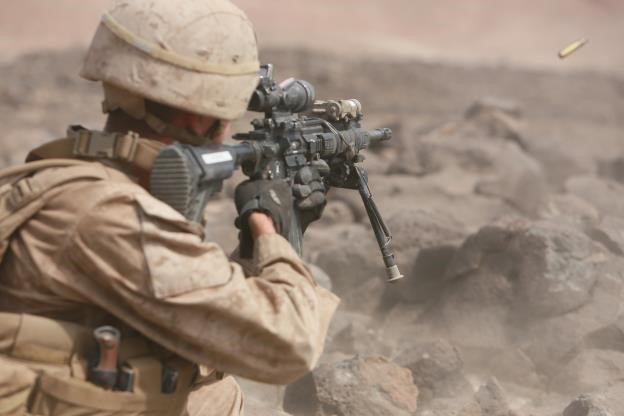 150729-M-TJ275-293   ARTA BEACH, Djibouti (July 29, 2015) A U.S. Marine with Light Armored Reconnaissance Detachment, Battalion Landing Team 3rd Battalion, 1st Marine Regiment, 15th Marine Expeditionary Unit, engages his target in a fire-and-maneuver exercise during sustainment training. Elements of the 15th MEU are ashore in Djibouti for sustainment training to maintain and enhance the skills they developed during their pre-deployment training period. The 15th MEU is currently deployed in support of maritime security operations and theater security cooperation efforts in the U.S. 5th and 6th Fleet areas of operation. (U.S. Marine Corps photo by Sgt. Steve H. Lopez/Released)