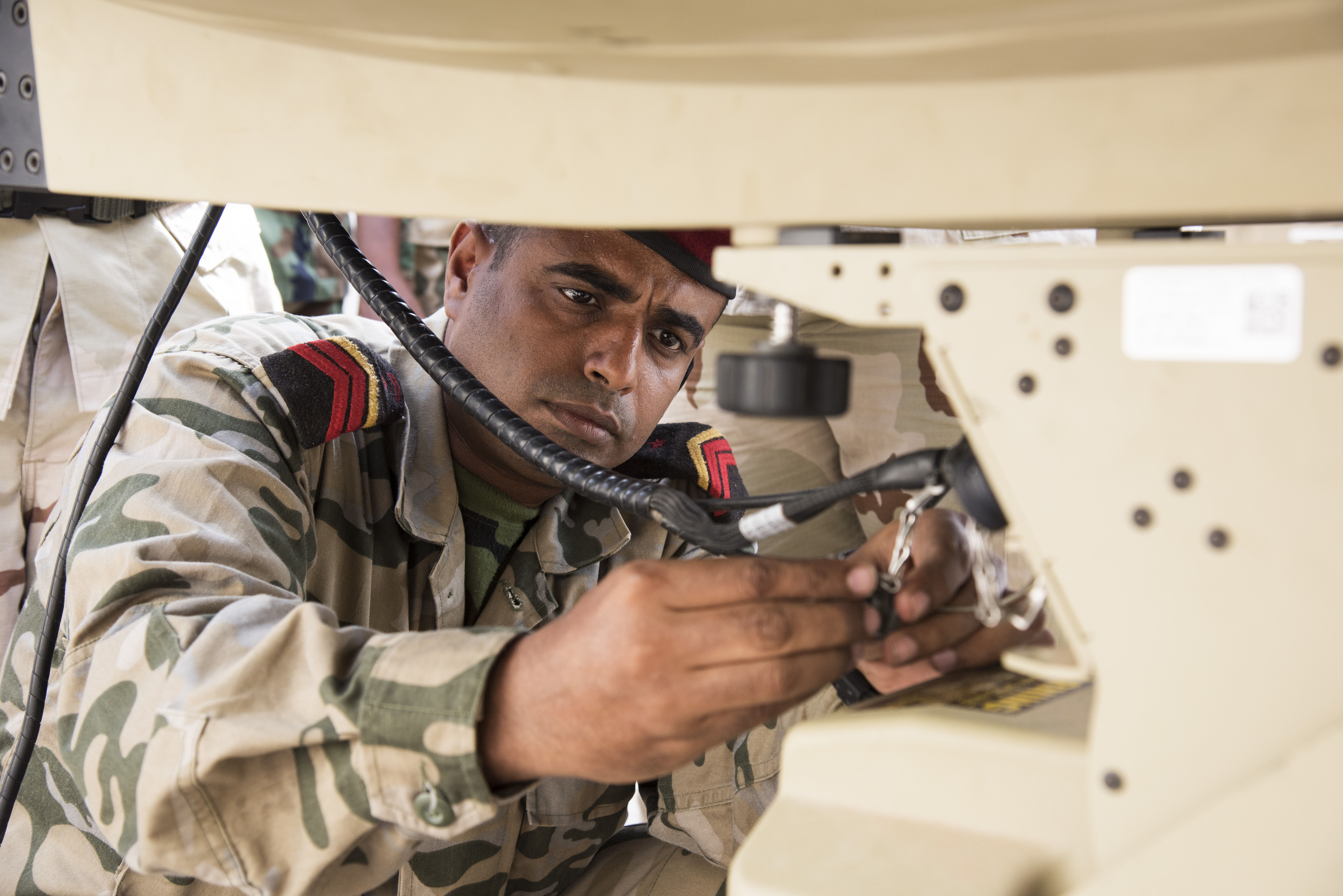 A member of the Djibouti Armed Forces (FAD) connects a cable connector during the setup of a U.S. Africa Command Data Sharing Network (ADSN) terminal at Camp Lemonnier, Djibouti, Aug. 31, 2015. FAD personnel were tested on how quickly they could setup and tear down the field communication system as part of a multi-week ADSN course, which was hosted by Combined Joint Task Force-Horn of Africa communications and intelligence personnel, and was designed to broaden communication interoperability between host nation security forces. (U.S. Air Force photo by Staff Sgt. Nathan Maysonet/released)