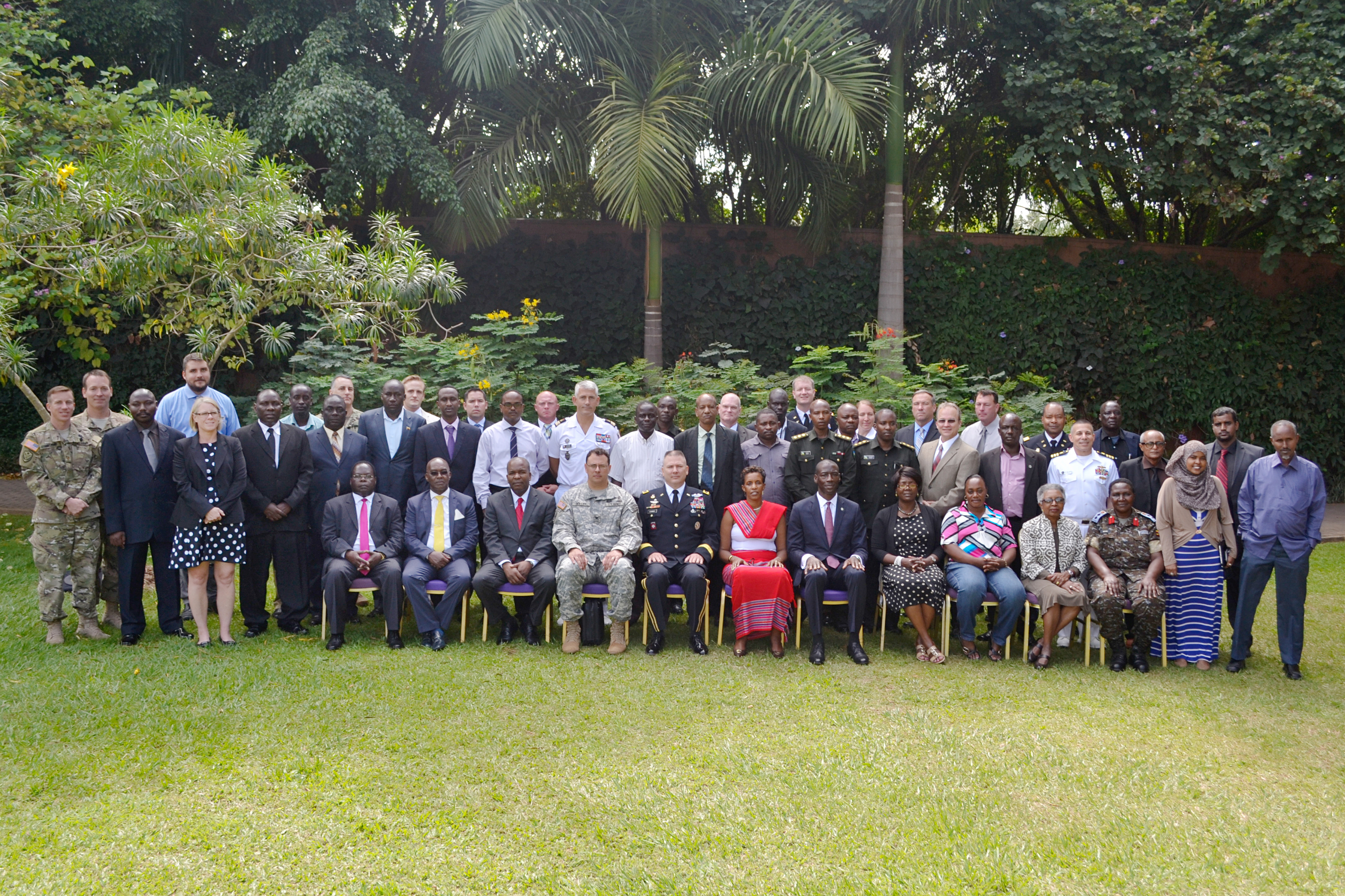Seminar participants pose for a group photo during the Africa Center for Strategic Studies Managing Security Resources in Africa Seminar, Kampala, Uganda. (CJTF-HOA photo, Released)