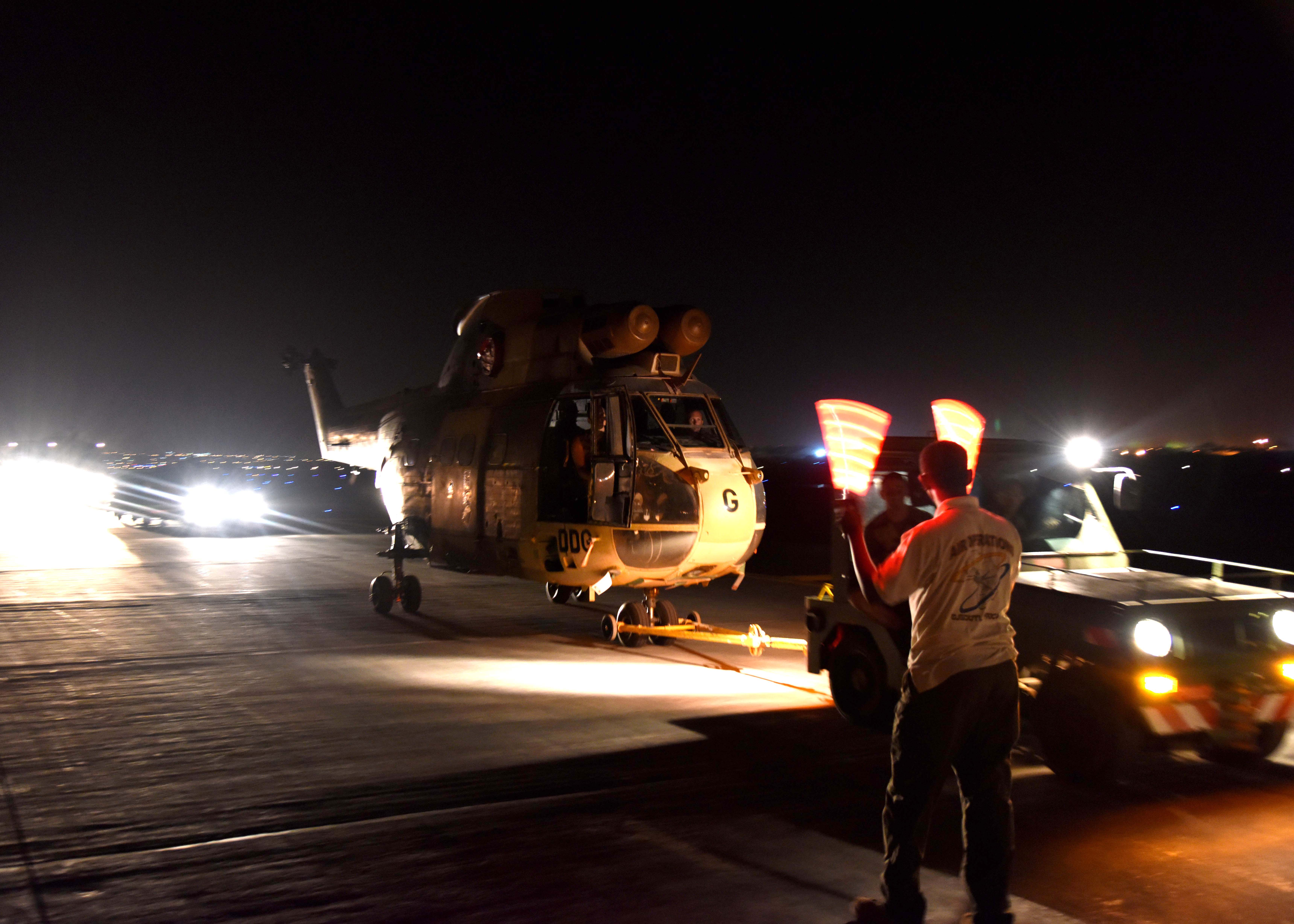 150822-N-DJ346-001 CAMP LEMONNIER, Djibouti (August 22, 2015) French and U.S. service members prepare to transport the first of two French Puma Helicopters and associated Passengers & Cargo to N'Djamena aboard a U.S. Air Force C-17 Globemaster. The helicopters support French operations at the intersecting borders of Libya, Chad and Niger deterring weapons and drug smuggling, and jihadist regularly crossing between nations. This is the first time France has received support from U.S. Forces in Djibouti for any mission outside of East Africa. (U.S. Navy photo by Chief Mass Communication Specialist Donald W. Randall/Released)