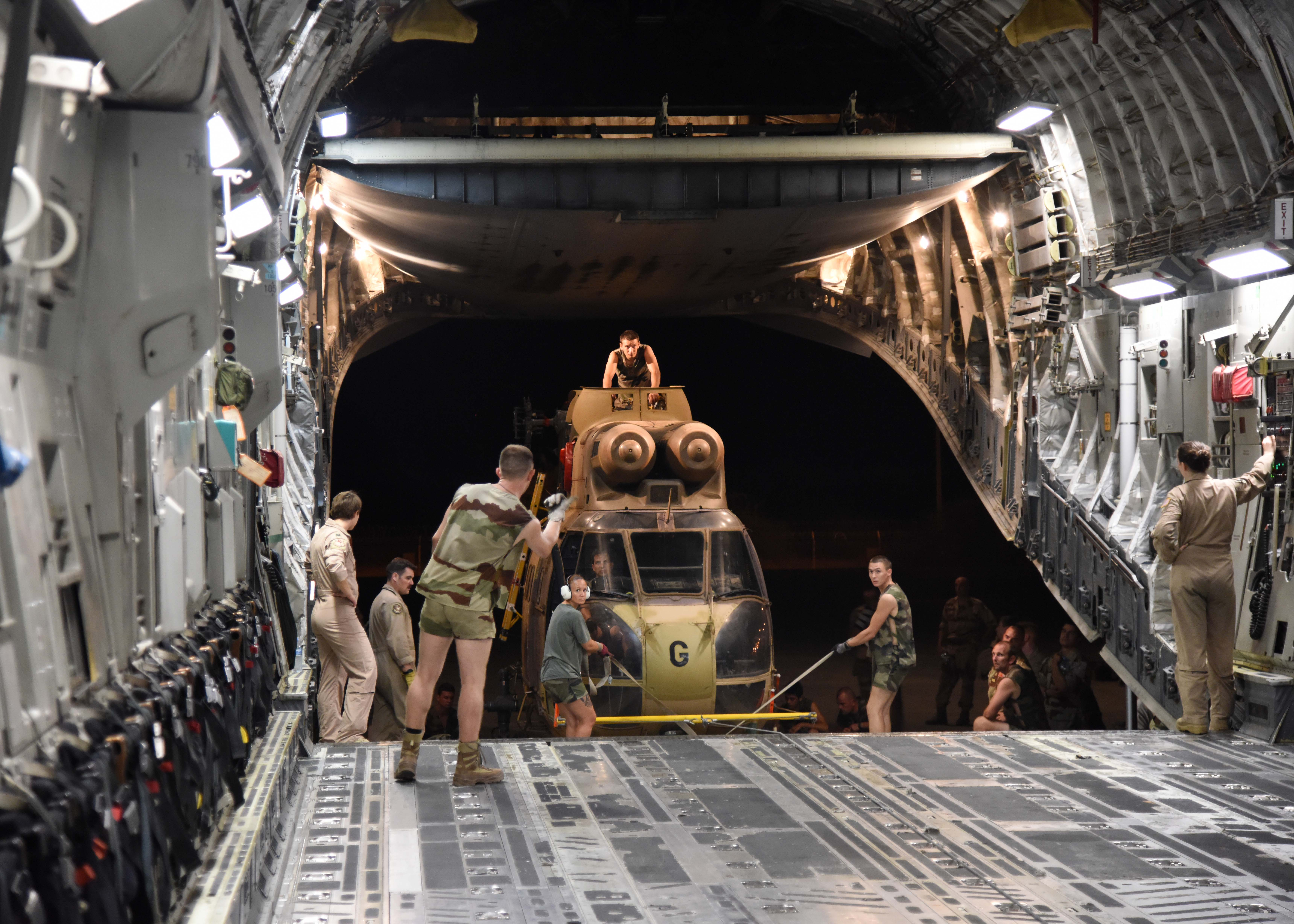 150822-N-DJ346-016 CAMP LEMONNIER, Djibouti (August 22, 2015) French and U.S. service members prepare to transport the first of two French Puma Helicopters and associated Passengers & Cargo to N'Djamena aboard a U.S. Air Force C-17 Globemaster. The helicopters support French operations at the intersecting borders of Libya, Chad and Niger deterring weapons and drug smuggling, and jihadist regularly crossing between nations. This is the first time France has received support from U.S. Forces in Djibouti for any mission outside of East Africa. (U.S. Navy photo by Chief Mass Communication Specialist Donald W. Randall/Released)