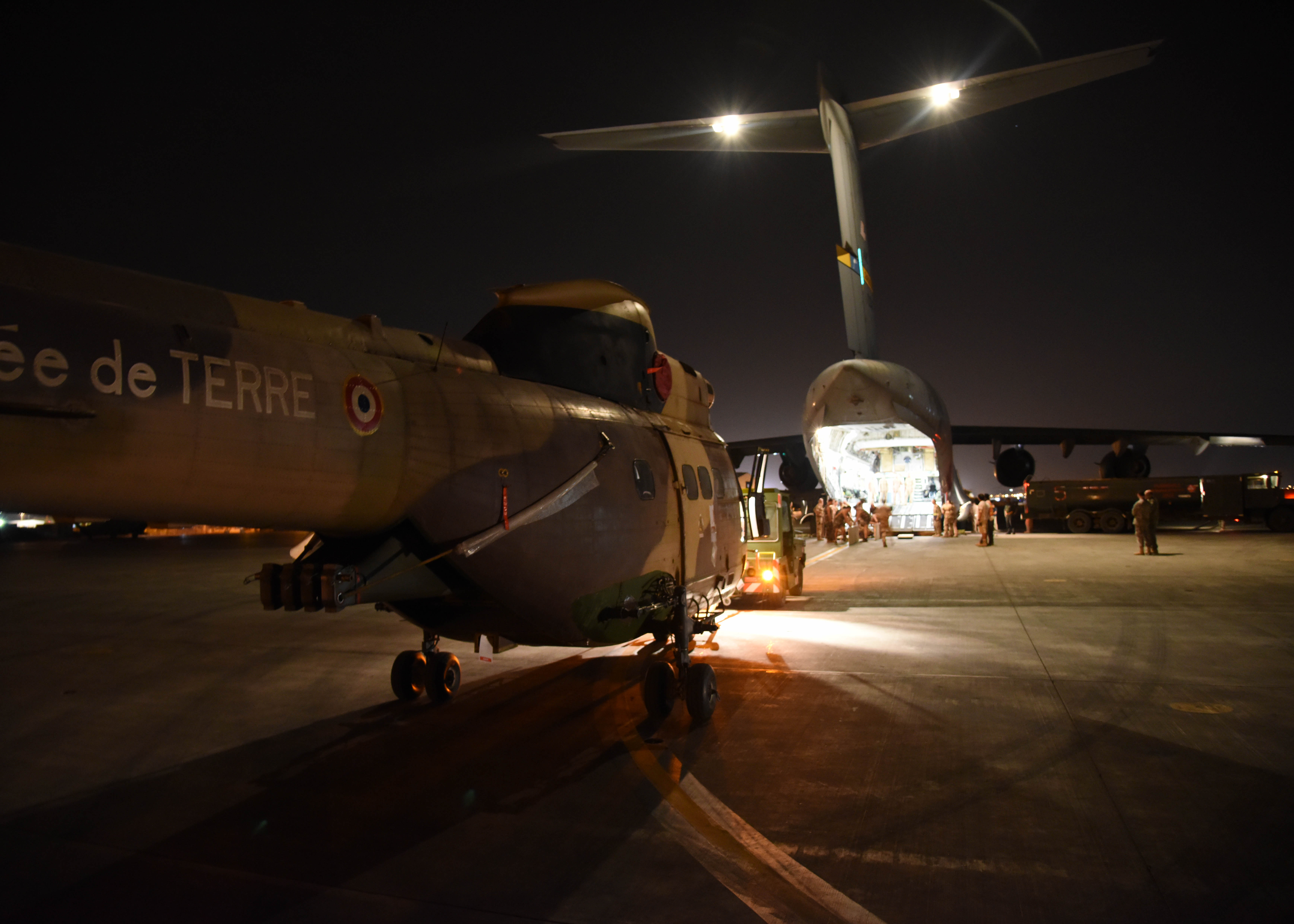 150822-N-DJ346-010 CAMP LEMONNIER, Djibouti (August 22, 2015) French and U.S. service members prepare to transport the first of two French Puma Helicopters and associated Passengers & Cargo to N'Djamena aboard a U.S. Air Force C-17 Globemaster. The helicopters support French operations at the intersecting borders of Libya, Chad and Niger deterring weapons and drug smuggling, and jihadist regularly crossing between nations. This is the first time France has received support from U.S. Forces in Djibouti for any mission outside of East Africa. (U.S. Navy photo by Chief Mass Communication Specialist Donald W. Randall/Released)