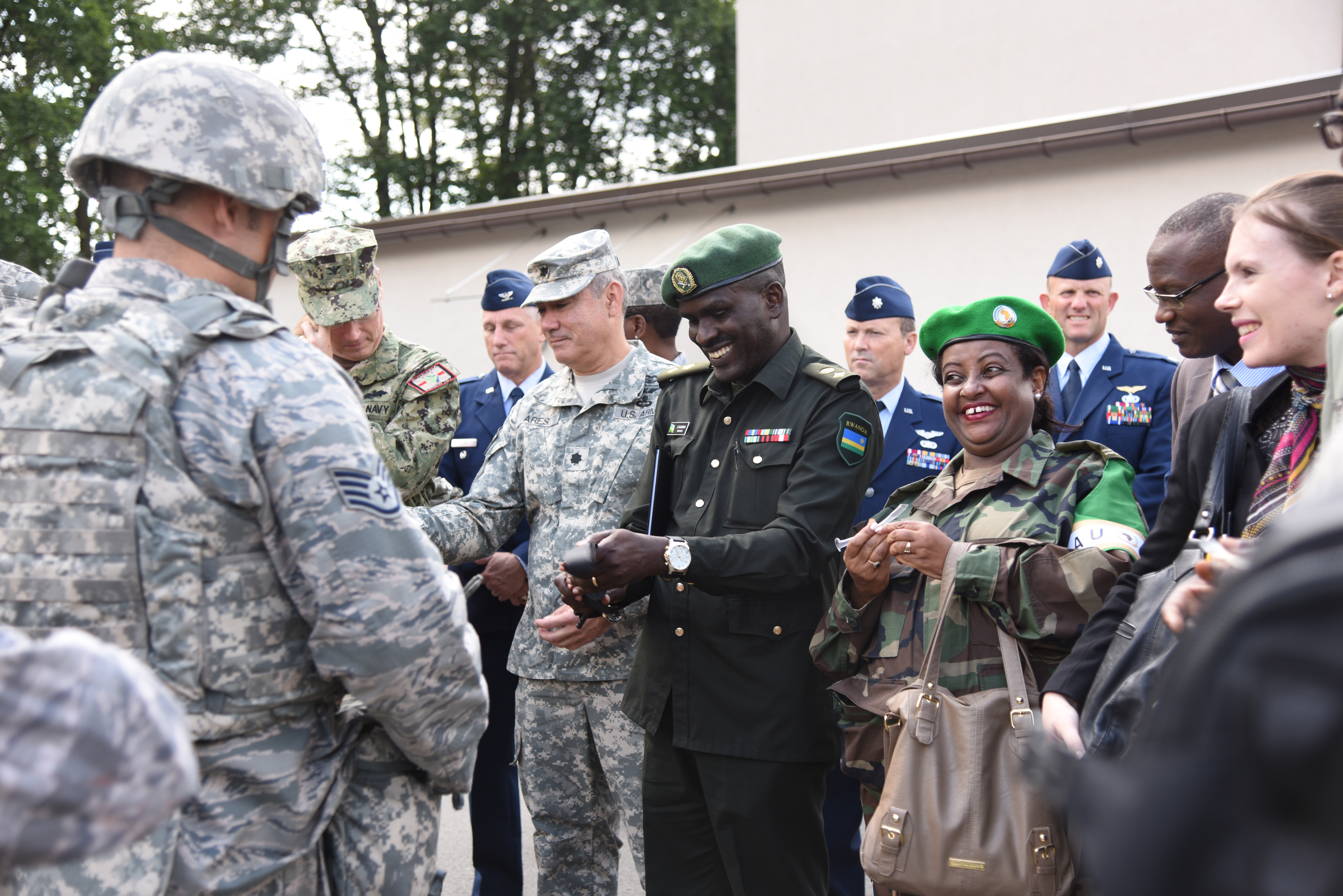 African Partnership Flights Surgeon General Symposium attendees learn tactical casualty combat care procedures during a demonstration at Ramstein AB, Germany, Aug. 25, 2015. This event focused on strengthening U.S. strategic partnerships with leading nations in Africa to enhance regional cooperation and interoperability.   (U.S. Air Force photo by Master Sgt. Charlene M. Spade/released)