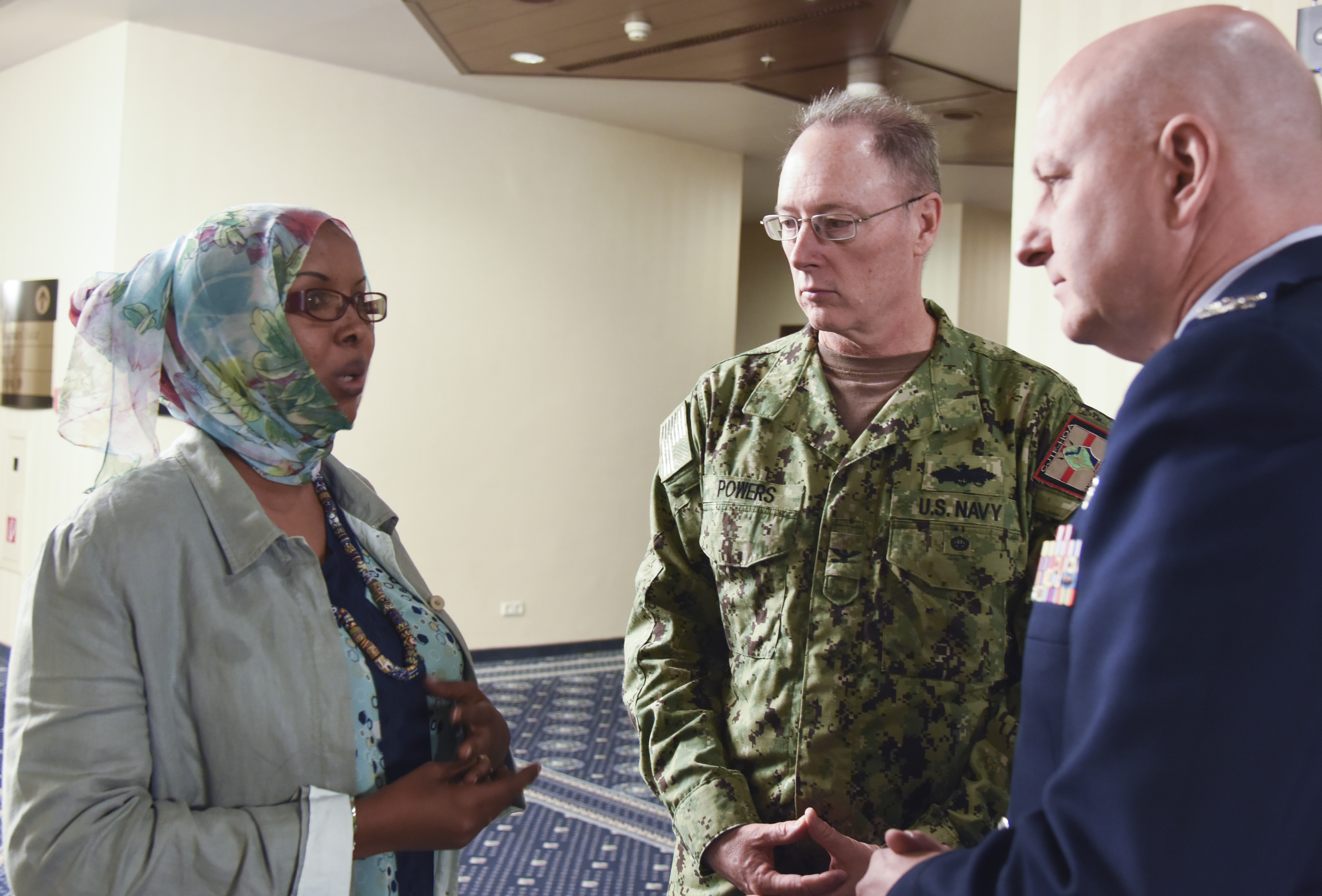 Djibouti Armed Forces Lt. Amina Ahmed Farah, Combined Joint Task Force-Horn of Africa Capt. Roland Powers and U.S. Air National Guard Col. Mike Cooper, discuss priorities in medical training at Ramstein AB, Germany, Aug. 25, 2015.  The goal of this symposium was for African partners to possess greater medical support capacity and the ability to sustain medical readiness through African institutions.  (U.S. Air Force photo by Master Sgt. Charlene M. Spade/released)