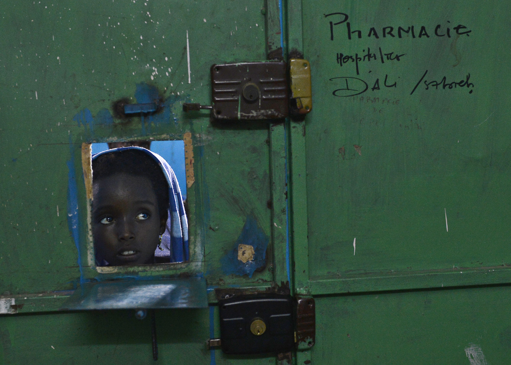 A child waits at a pharmacy window at the Ali Sabieh Medical Clinic in Djibouti, Africa, Sept. 12, 2015. Combined Joint Task Force-Horn of Africa partnered with Djibouti's Ministry of Health to host a Medical Civic Action Program outreach event. They provided an obstetrician-gynecologist, pediatrician, dentist and ophthalmologist for the rural people. (U.S. Air Force photo by Senior Airman Nesha Humes)