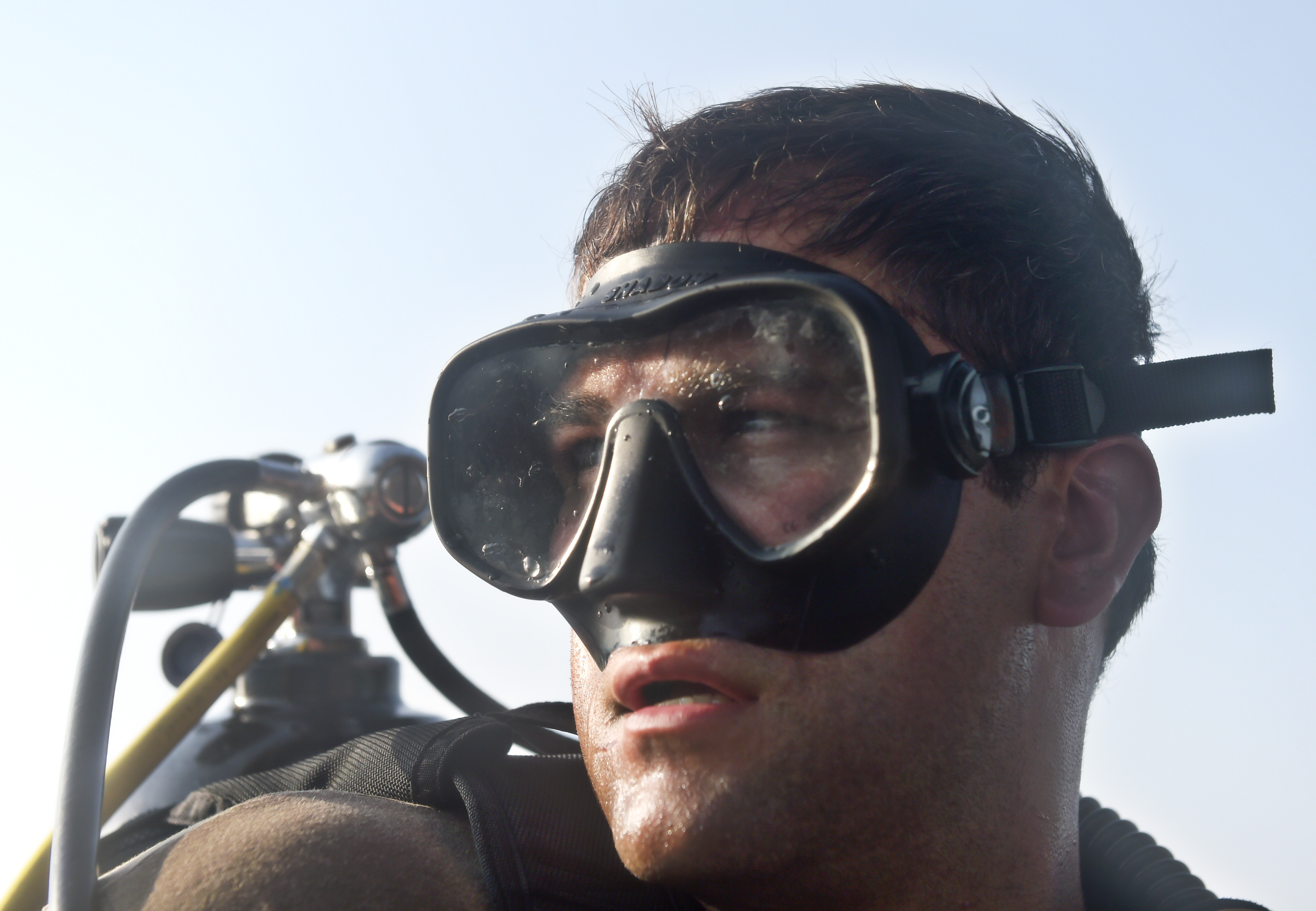 A U.S. Navy Explosive Ordnance Disposal technician prepares for a routine anti-terrorism force protection dive off the coast of Djibouti, Africa, Sept. 22, 2015. Assigned to Combined Joint Task Force-Horn of Africa, EOD technicians are trained to disarm explosive devices and clear underwater obstructions. (U.S. Air Force photo by Senior Airman Nesha Humes)