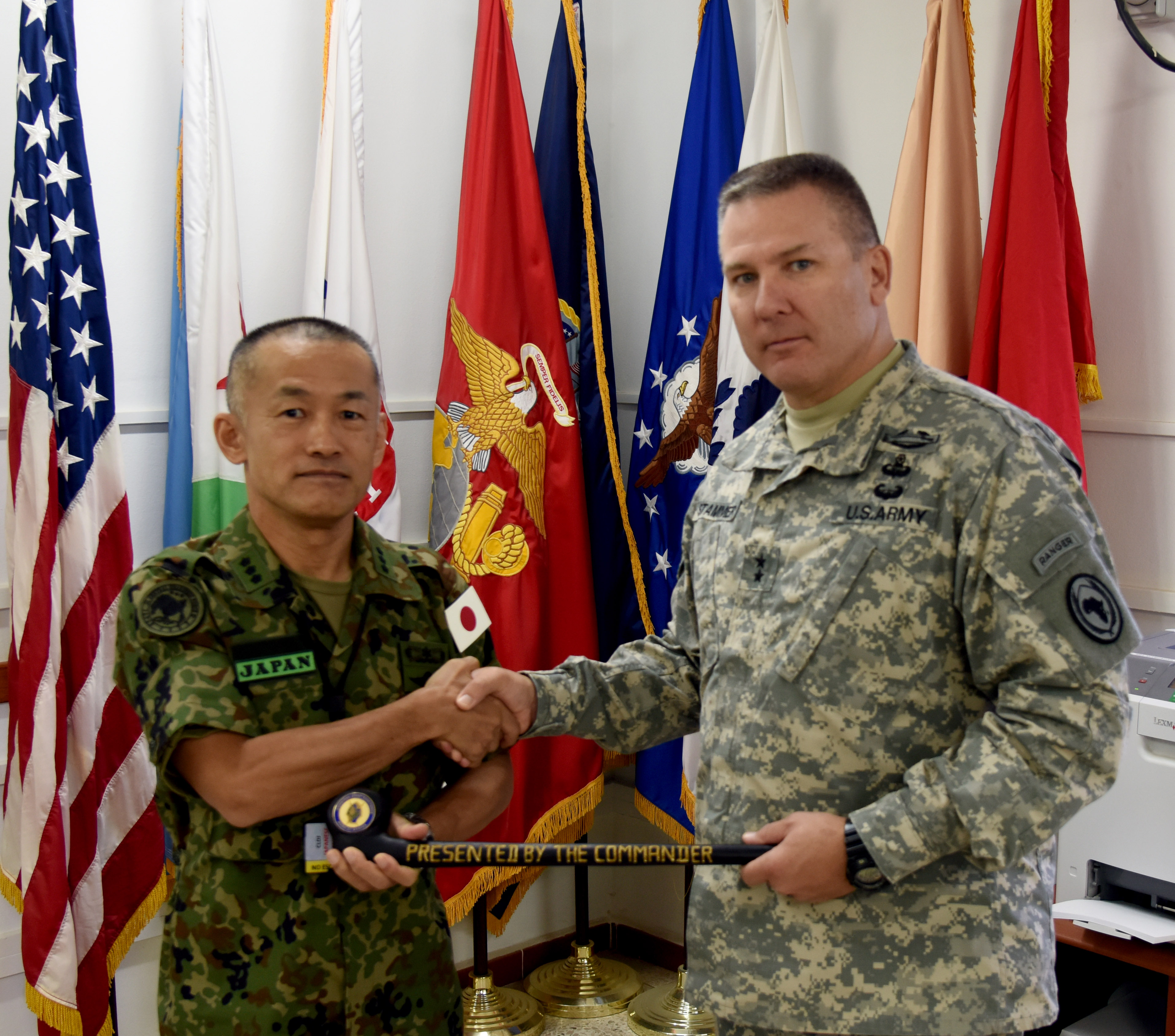151009-N-DJ346-020 CAMP LEMONNIER, Djibouti (October 9, 2015) Major General Mark R. Stammer, Commanding General, Combined Joint Task Force – Horn of Africa, presents Lt. Gen. Hiromichi Kawamata, Commanding General, Japan Ground Self Defense Force, Central Readiness Force, with a Maasai rungu baton. The two leaders met to discuss future objectives and information sharing opportunities. General Stammer told General Kawamata that Japanese Defense Forces are and remain valued friends and partners of CJTF-HOA. (U.S. Navy photo by Chief Mass Communication Specialist Donald W. Randall/Released)