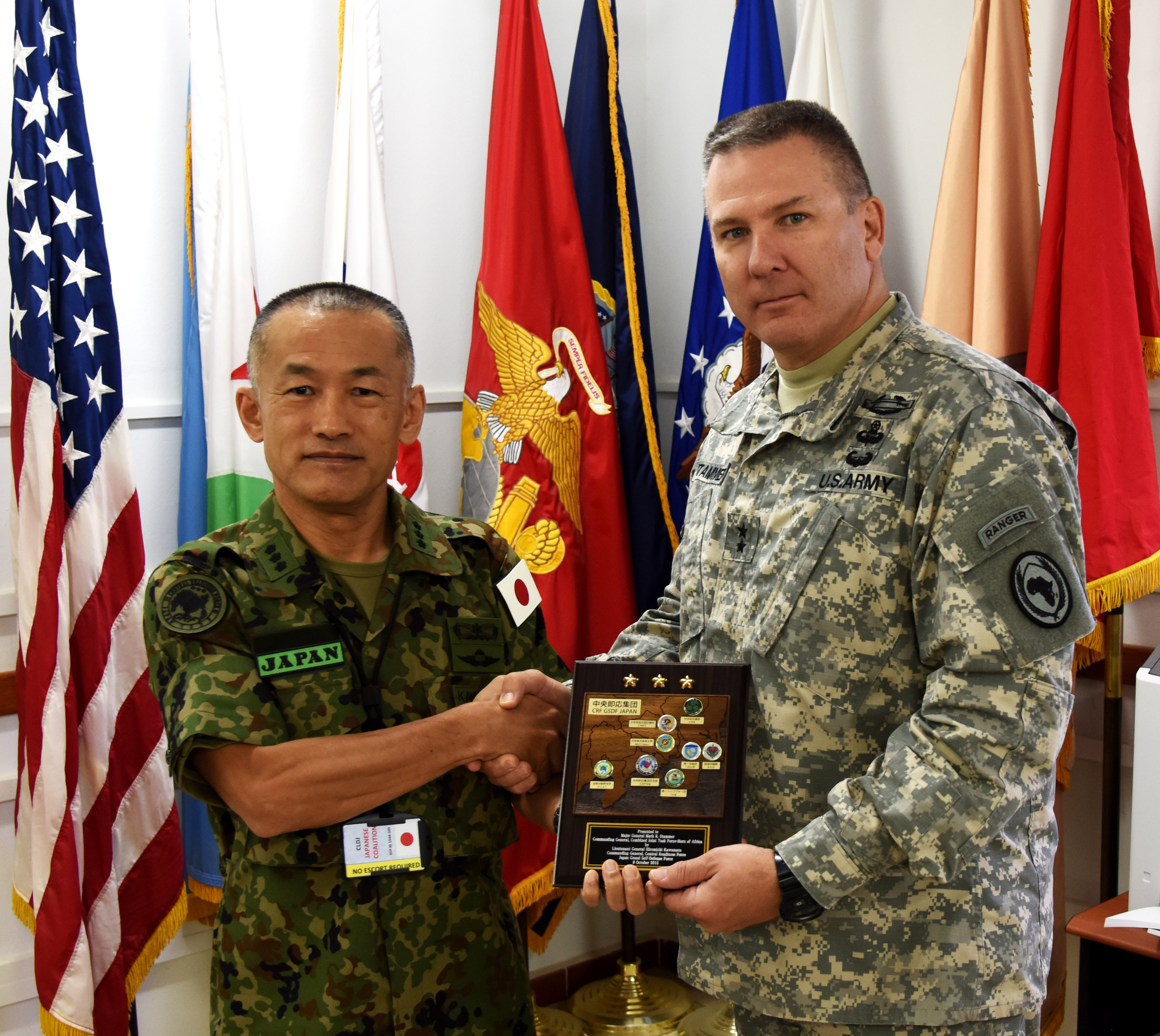 151009-N-DJ346-018 CAMP LEMONNIER, Djibouti (October 9, 2015) Lt. Gen. Hiromichi Kawamata, Commanding General, Japan Ground Self Defense Force, Central Readiness Force, presents Major General Mark R. Stammer, Commanding General, Combined Joint Task Force – Horn of Africa, with a plaque. The two leaders met to discuss future objectives and information sharing opportunities. General Stammer told General Kawamata that Japanese Defense Forces are and remain valued friends and partners of CJTF-HOA. (U.S. Navy photo by Chief Mass Communication Specialist Donald W. Randall/Released)