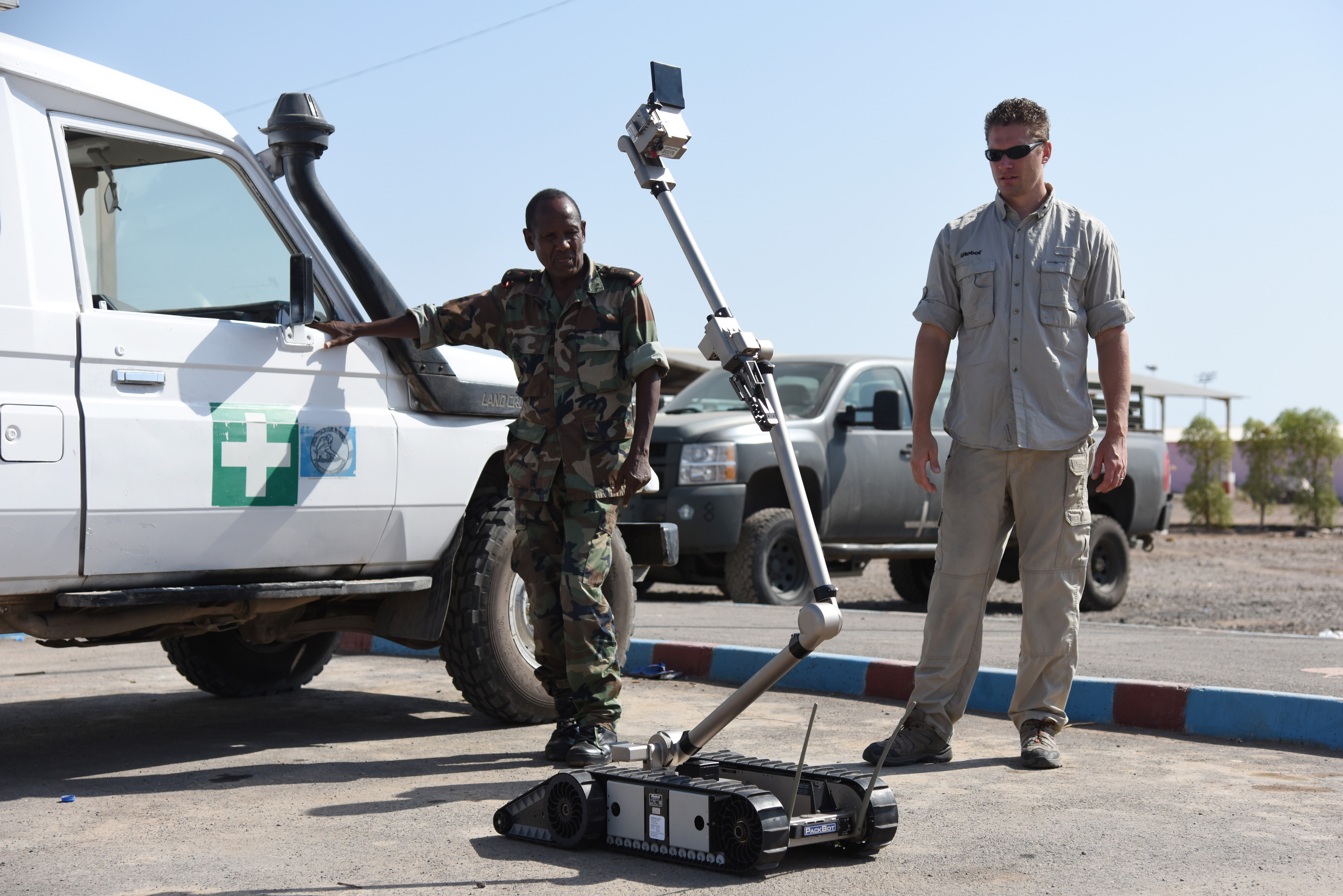 Joseph Brunette, iRobot instructor, shows Djibouti Armed Forces (FAD) service members how to use a 510 Packbot to search for explosive devices in Djibouti, Oct. 12, 2015.  The robot can be used to search confined spaces, clear routes and buildings, and inspect vehicles. (U.S. Air Force photo by Staff Sgt. Maria Bowman)