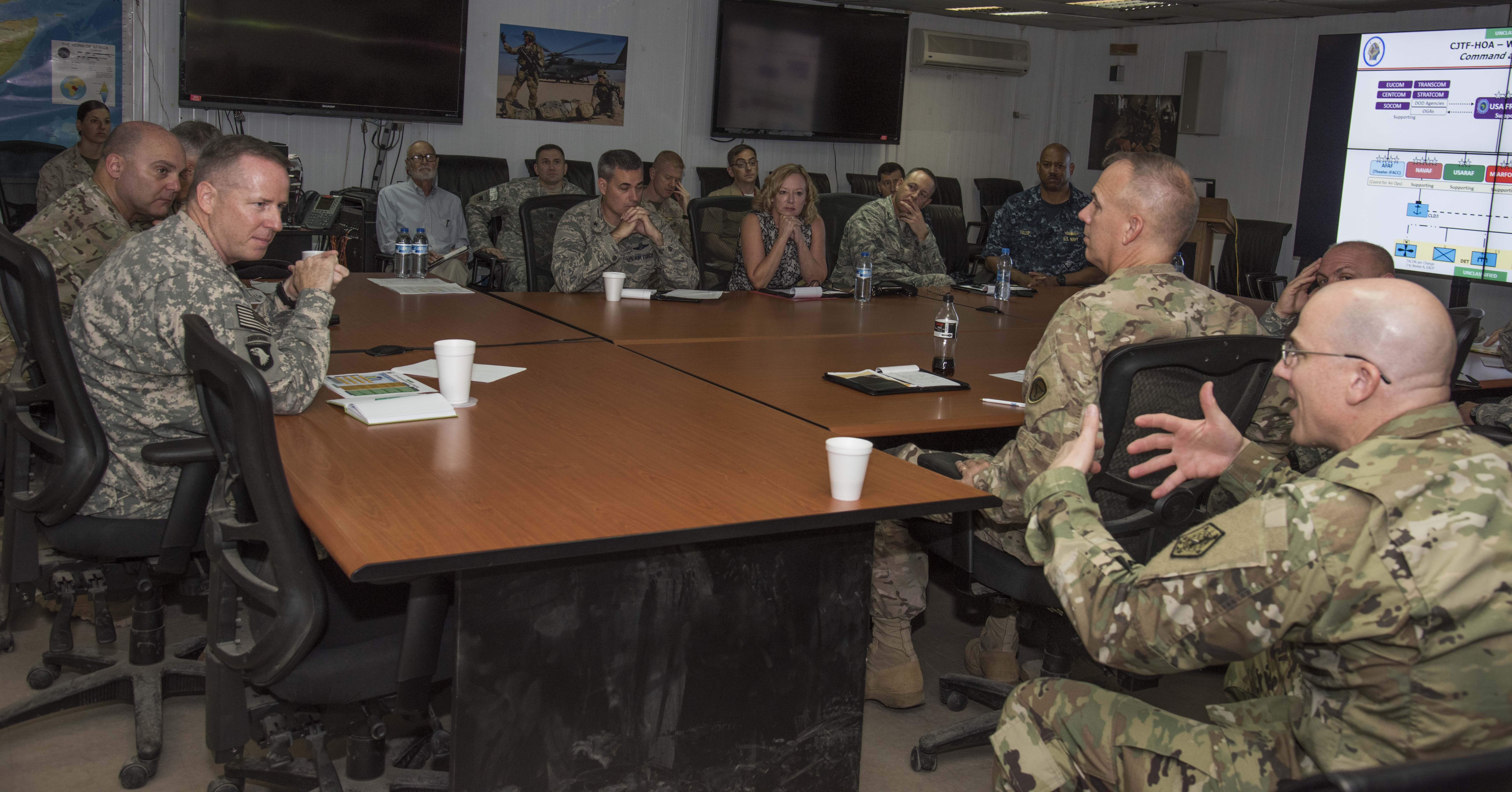 Fellows from the 2016-1 CAPSTONE course ask questions of Combined Joint Task Force-Horn of Africa senior staff during their mission brief at Camp Lemonnier, Djibouti, Oct. 14, 2015. CAPSTONE is a five-week course for newly selected general and flag officers, and is designed to make the senior officers more effective in planning and employing forces in joint and combined operations.  (U.S. Air Force photo by Staff Sgt. Victoria Sneed)
