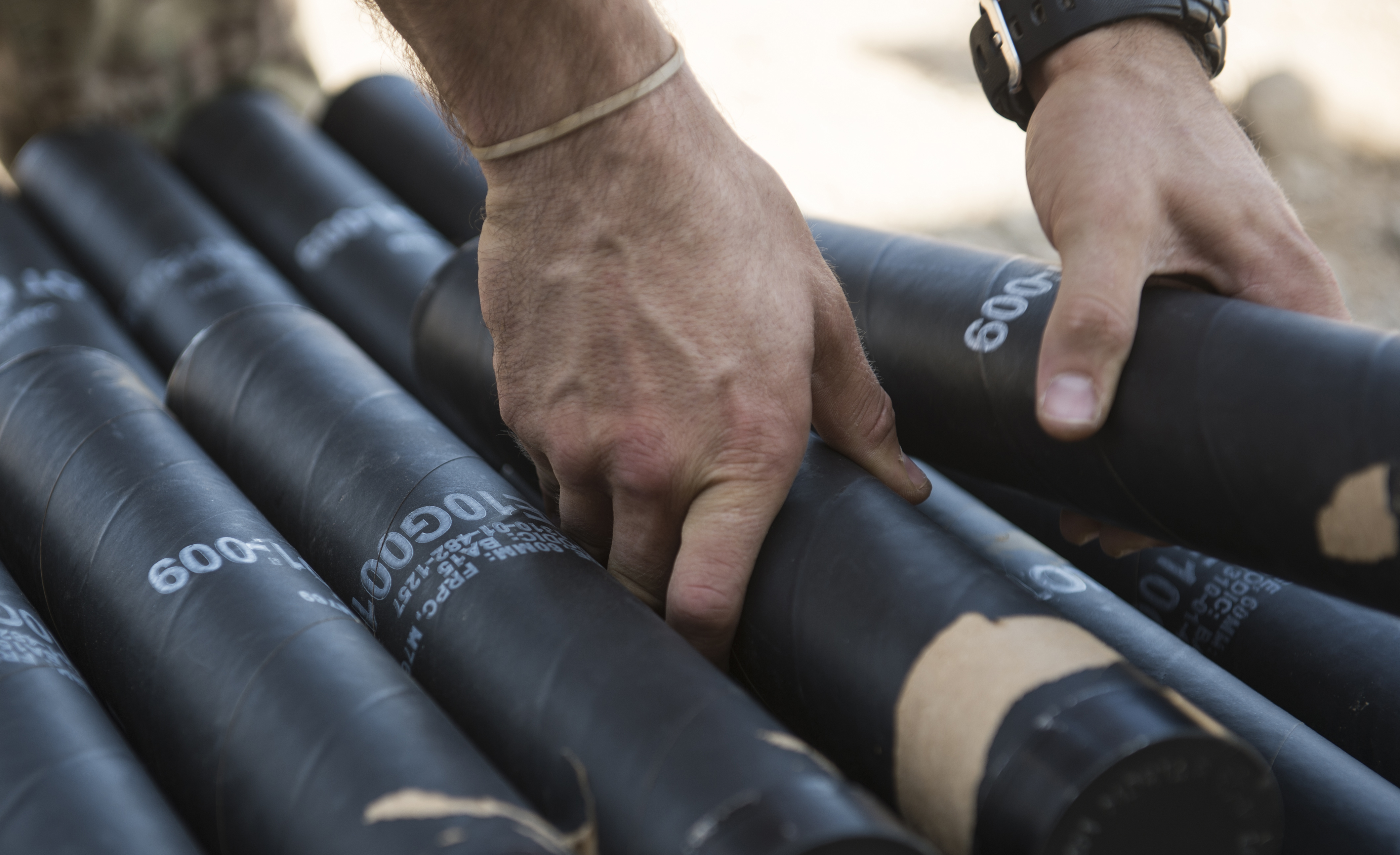 U.S. Army Sgt. Nicholas Mormando, Alpha Company, 3rd Battalion, 15th Infantry Regiment, places two mortar tubes on a stack of mortars Oct. 12, 2015, in Arta Djibouti. As mortar men attached to the East Africa Response Force, soldiers from Alpha Company employ crew and weapons in offensive and defensive ground combat, carry out scout missions to spot enemy troops and locations, and employ, fire and recover anti-tank mines. (U.S. Air Force photo by Senior Airman Peter Thompson/Released)